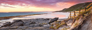 Eleven Mile beach summer evening rocky foreground with pink sky Esperance panorama