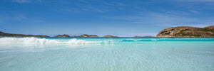 Lucky Bay aqua curling wave with large rock panorama in Esperance