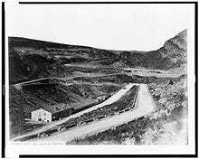 1860 Photo Valencia. Zig-zag de las Cabrillas Road zig-zagging up a mountain with building (inn?) on left side of photograph. Location: Spain