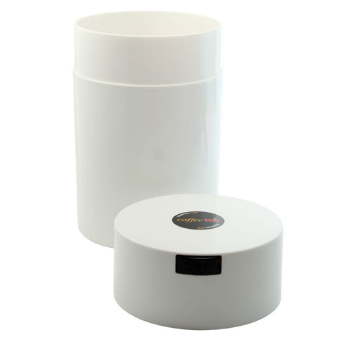 White Coffeevac with lid beside canister