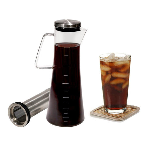 Handi Home cold brew coffee maker next to glass of cold brew coffee