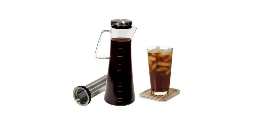 Handi Home cold brew brew coffee maker next to glass of cold brew