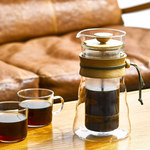 French press made from glass and olive wood