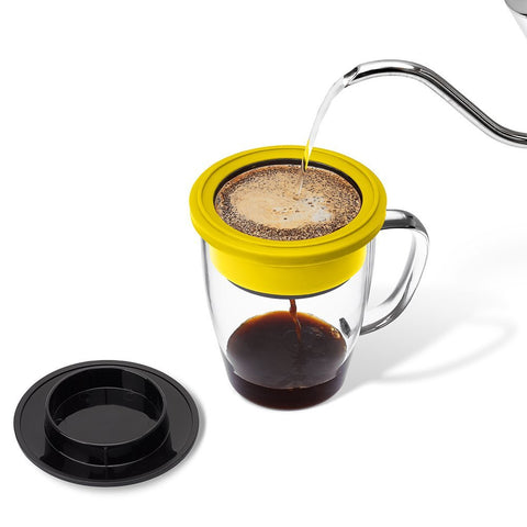 Travel pour over coffee maker in use