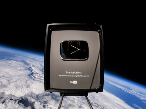 Ryan Taylor ryantaylorbmx YouTube Silver Play button for 100,000 subscribers in space
