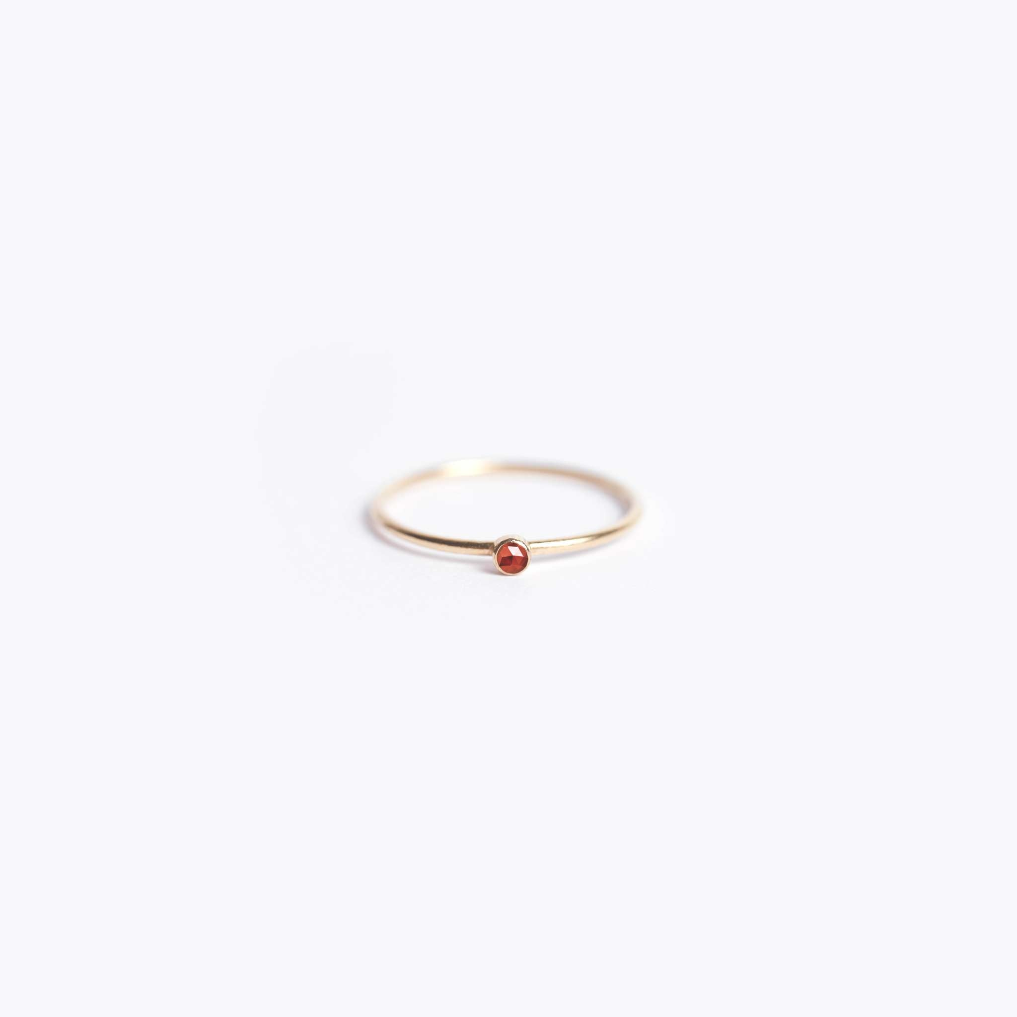 Wanderlust Life Ethically Handmade jewellery made in the UK. Minimalist gold and fine cord jewellery. january birthstone, fine gold garnet ring