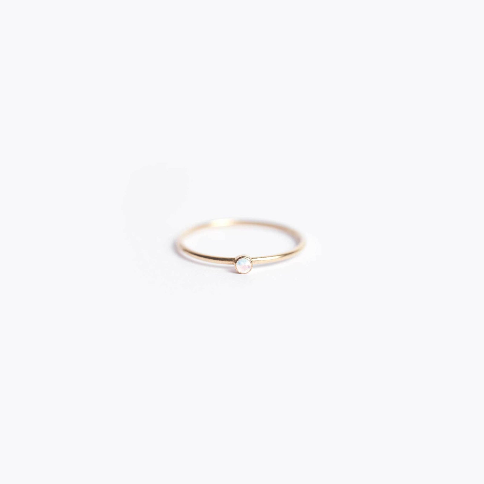 Wanderlust Life Ethically Handmade jewellery made in the UK. Minimalist gold and fine cord jewellery. unity ring, moonstone