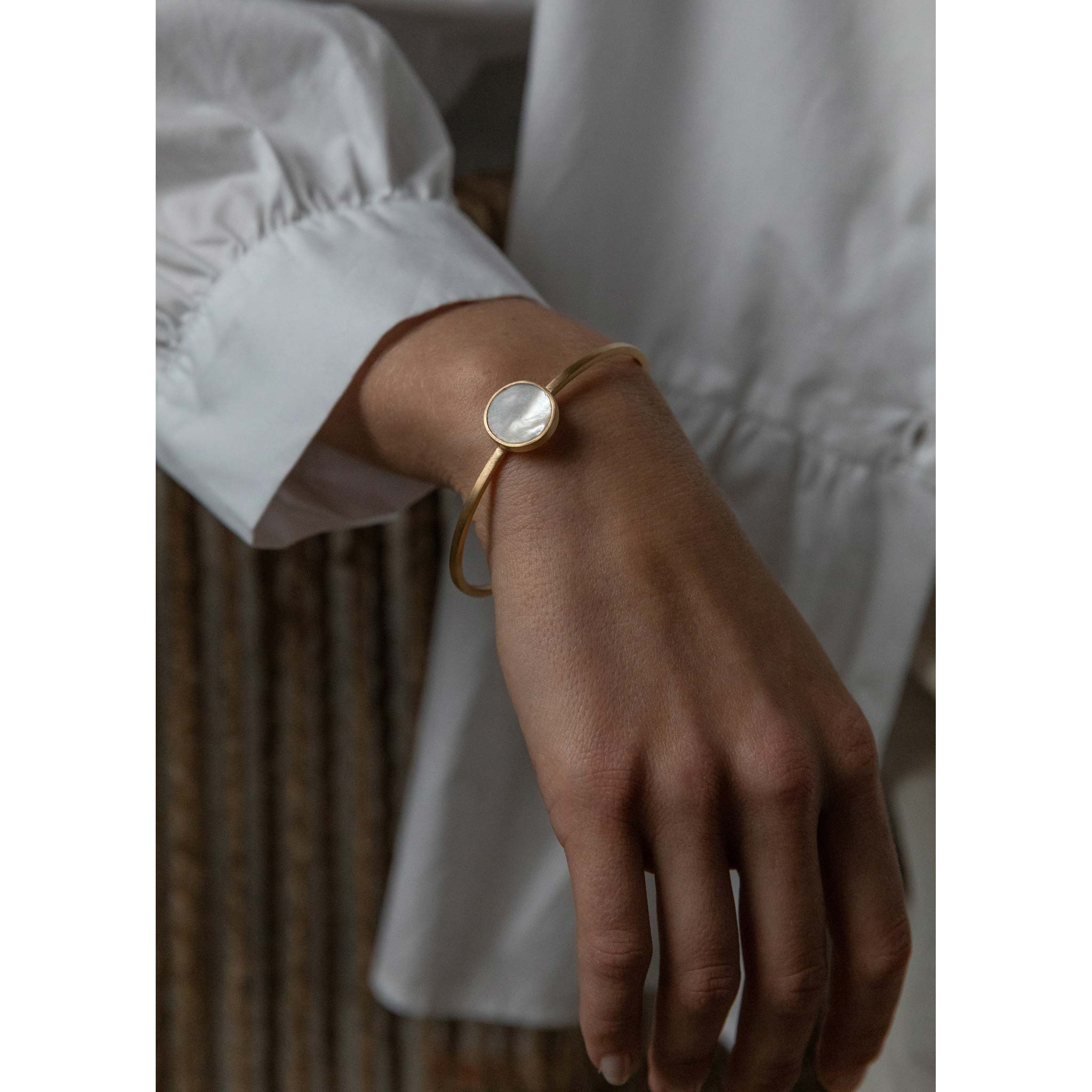 Wanderlust Life mother of pearl bracelet. Gold cuff available in one size. Handmade bracelet in the UK.