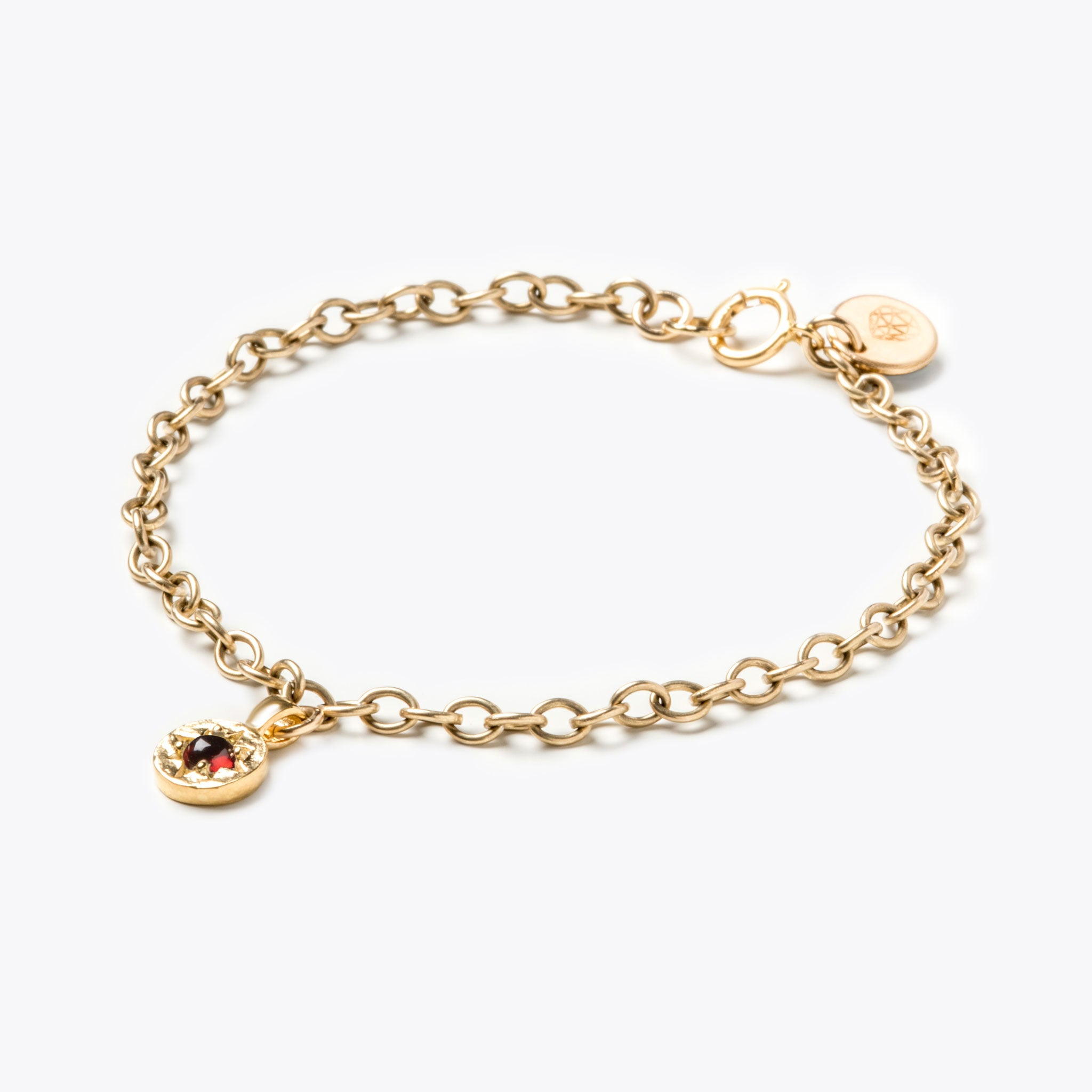 Wanderlust Life January birthstone 14k gold fill charm bracelet featuring semi precious garnet gemstone symbolising the month of January. January birthstone gold bracelet available in small & medium adjustable gold chain. Wanderlust Life handmade jewellery made in Devon, UK.