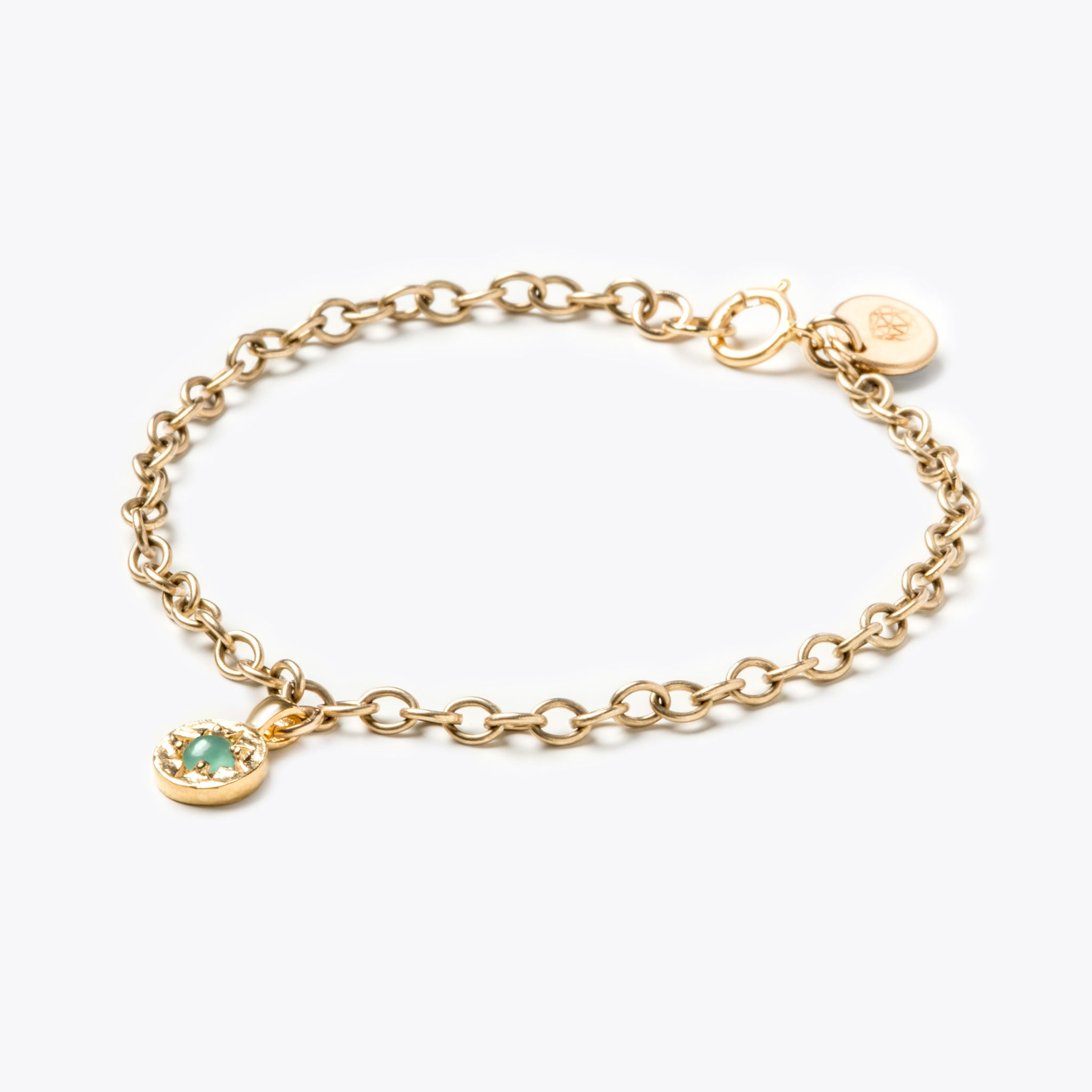 Wanderlust Life May birthstone 14k gold fill charm bracelet featuring semi precious green emerald gemstone symbolising the month of May. May birthstone gold bracelet available in an adjustable small 6.5
