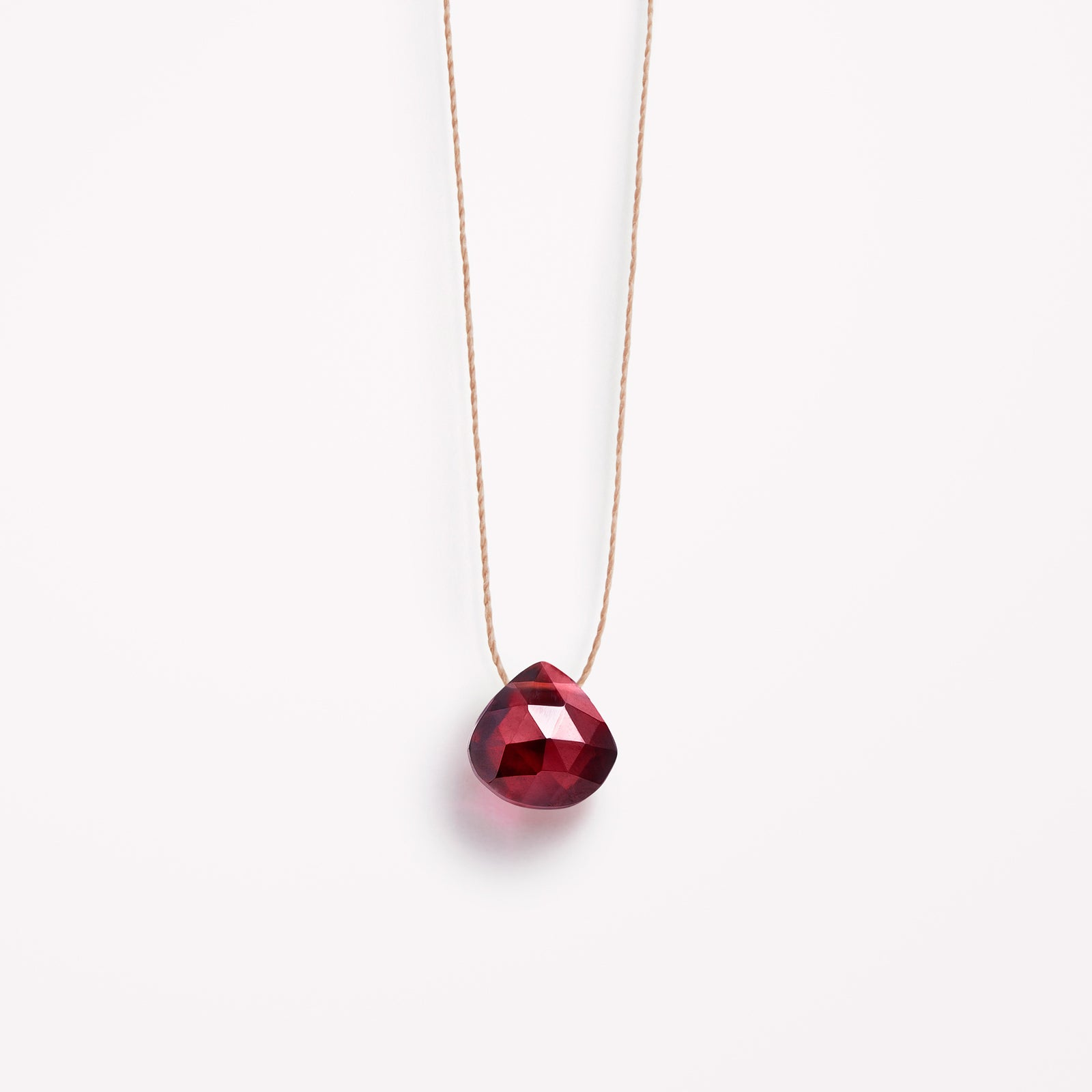 Wanderlust Life Ethically Handmade jewellery made in the UK. Minimalist gold and fine cord jewellery. january birthstone, garnet fine cord necklace