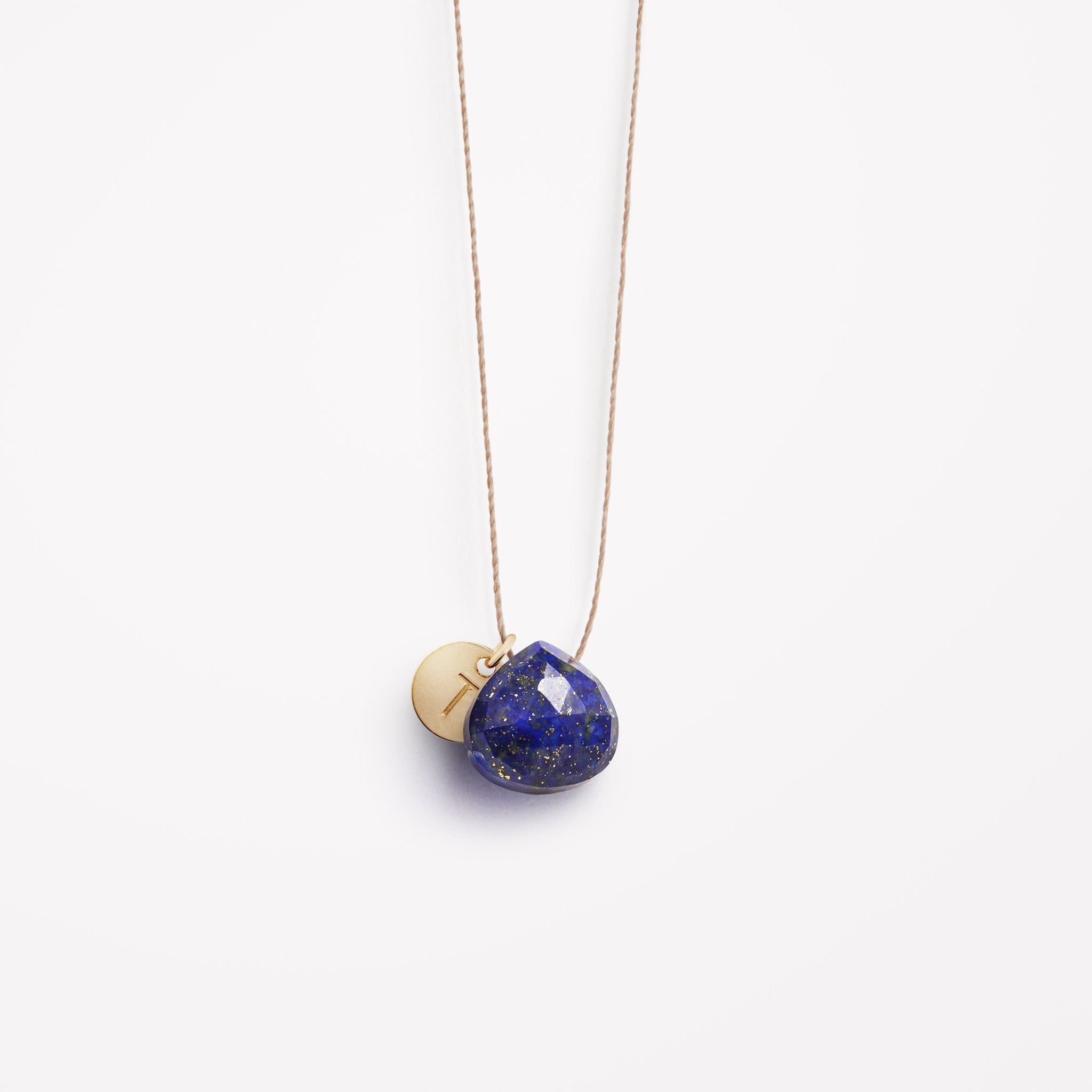 Wanderlust Life Ethically Handmade jewellery made in the UK. Minimalist gold and fine cord jewellery. Personalised bestselling blue lapis lazuli gemstone fine cord necklace with gold personalised initial tag.