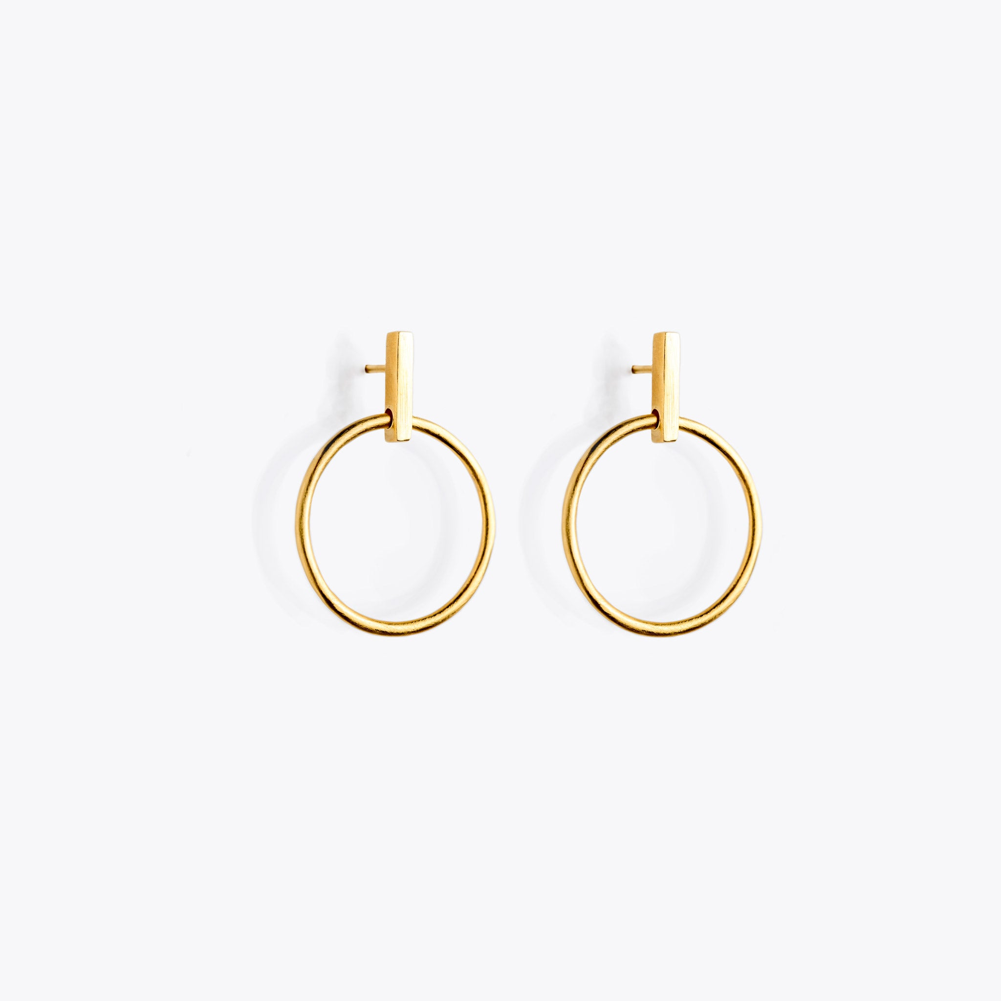 Wanderlust Life Ethically Handmade jewellery made in the UK. Minimalist gold and fine cord jewellery. solar gold halo earring