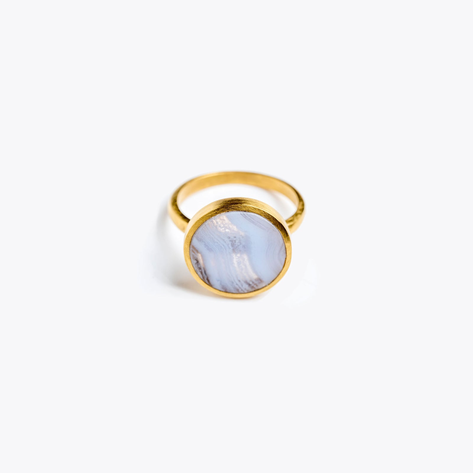 Wanderlust Life Ethically Handmade jewellery made in the UK. Minimalist gold and fine cord jewellery. solar ring, blue lace agate