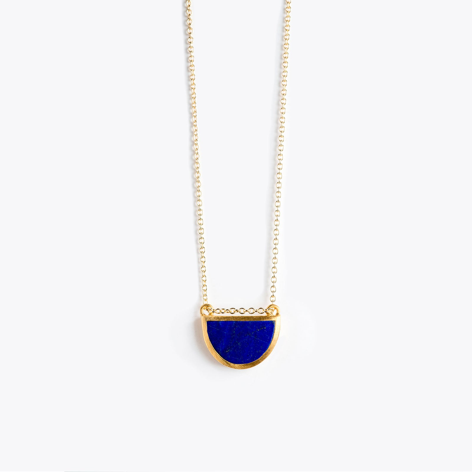 Wanderlust Life Ethically Handmade jewellery made in the UK. Minimalist gold and fine cord jewellery. sunburst fine gold chain necklace, lapis lazuli