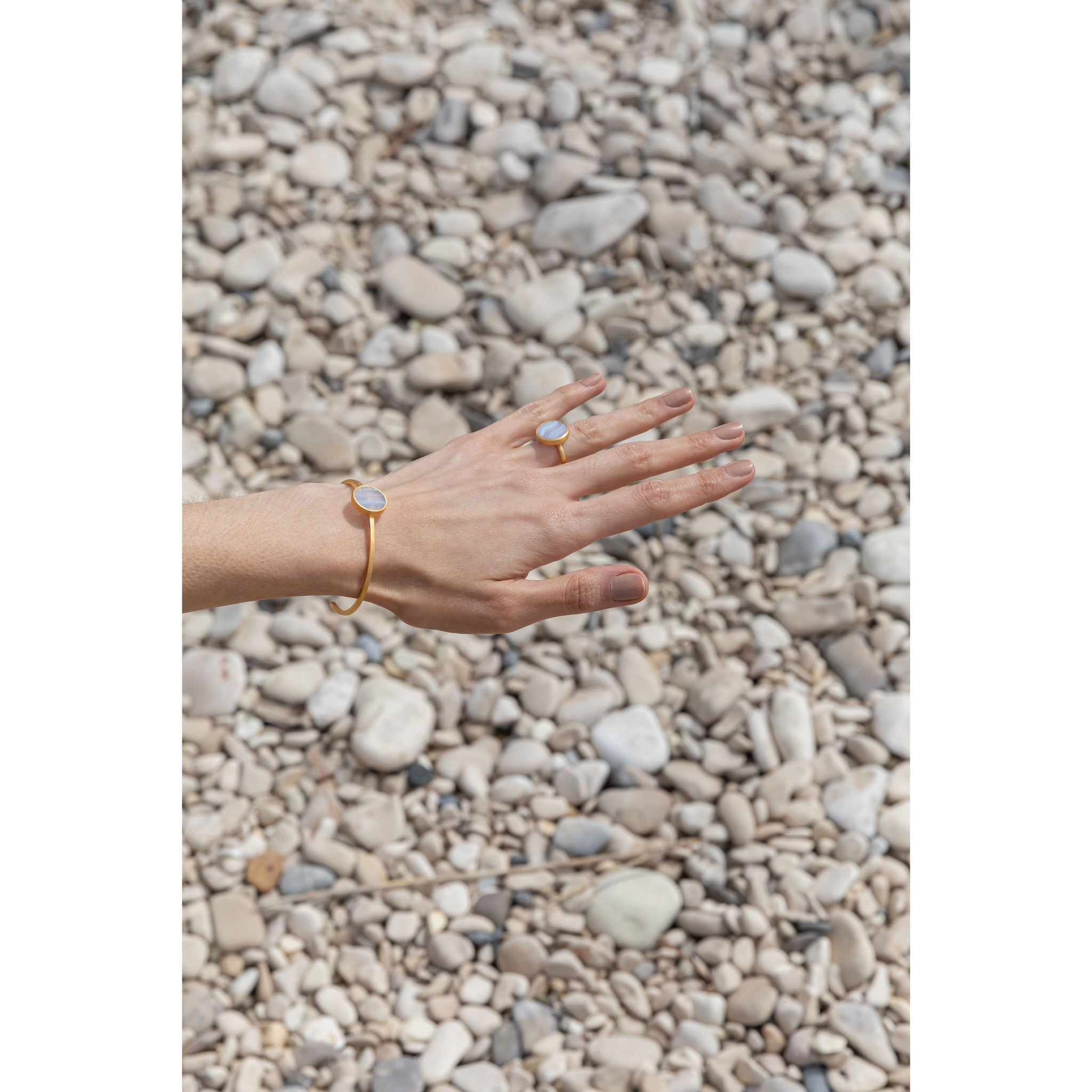 Wanderlust Life Ethically Handmade jewellery made in the UK. Minimalist gold and fine cord jewellery. solar gold cuff, blue lace agate