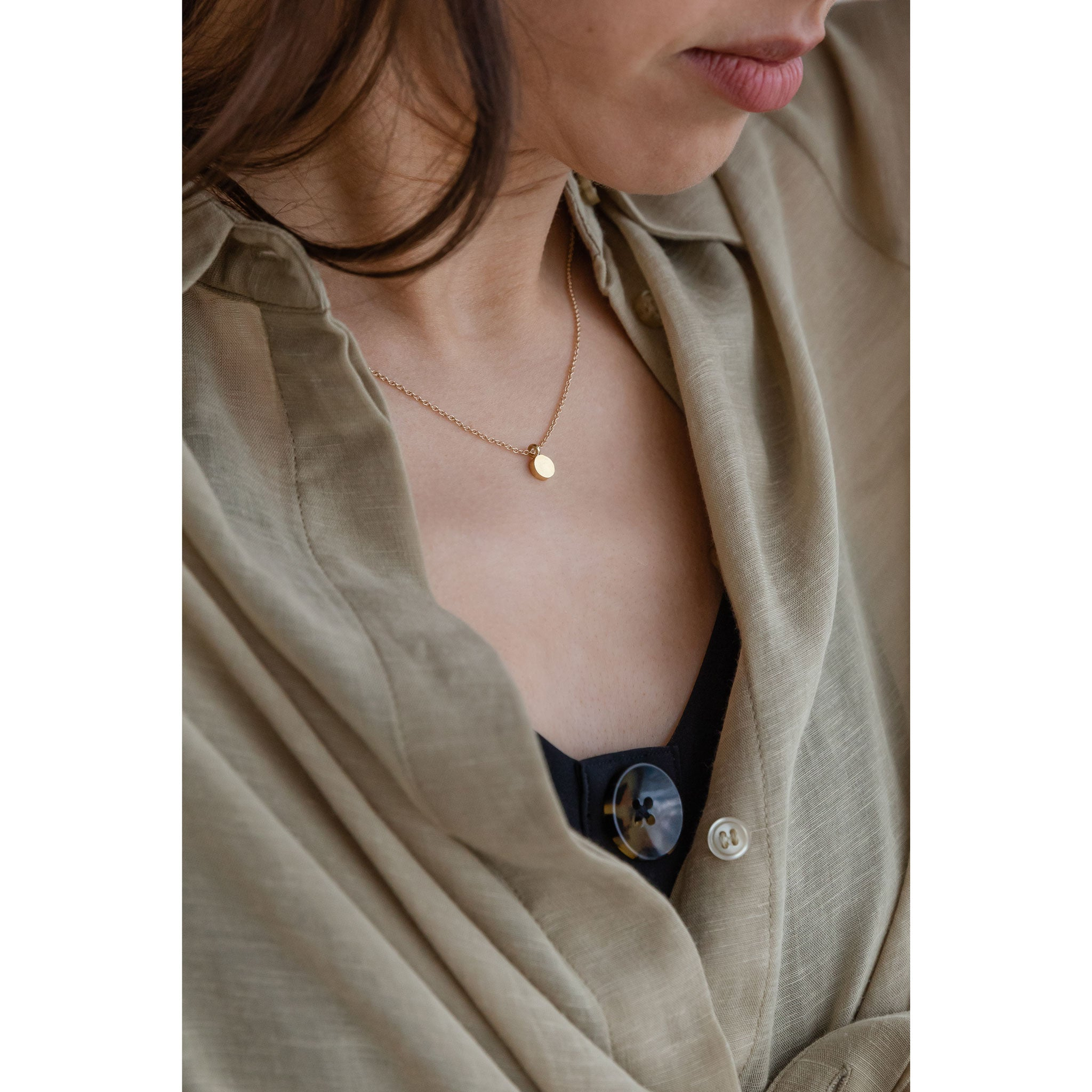 Wanderlust Life Ethically Handmade jewellery made in the UK. Minimalist gold and fine cord jewellery. petite solar pendant necklace