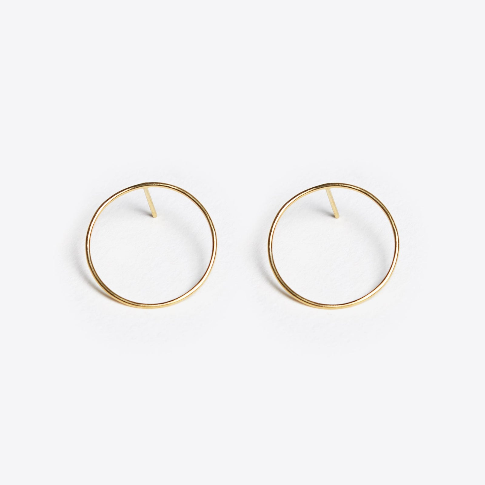 Wanderlust Life Ethically Handmade jewellery made in the UK. Minimalist gold and fine cord jewellery. unity circle hoop stud earring