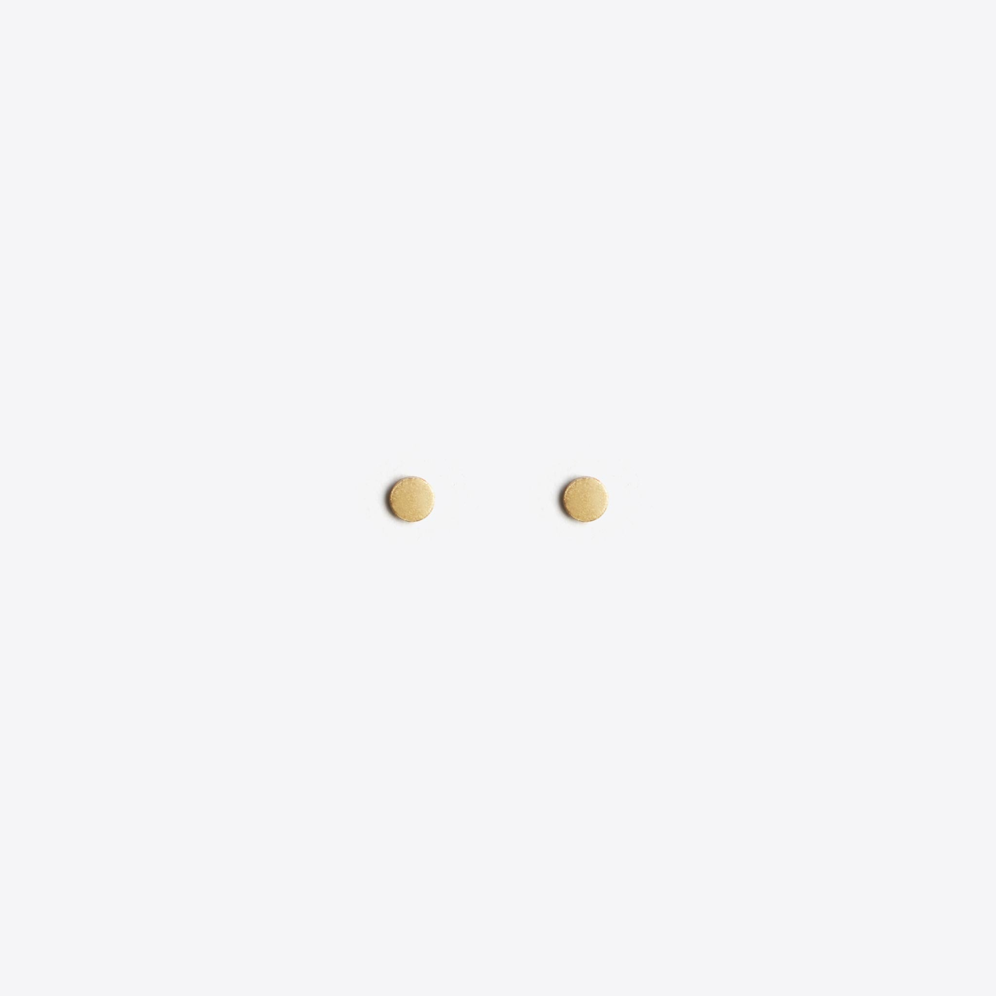 Wanderlust Life Ethically Handmade jewellery made in the UK. Minimalist gold and fine cord jewellery. gold stud earring, petite unity circle