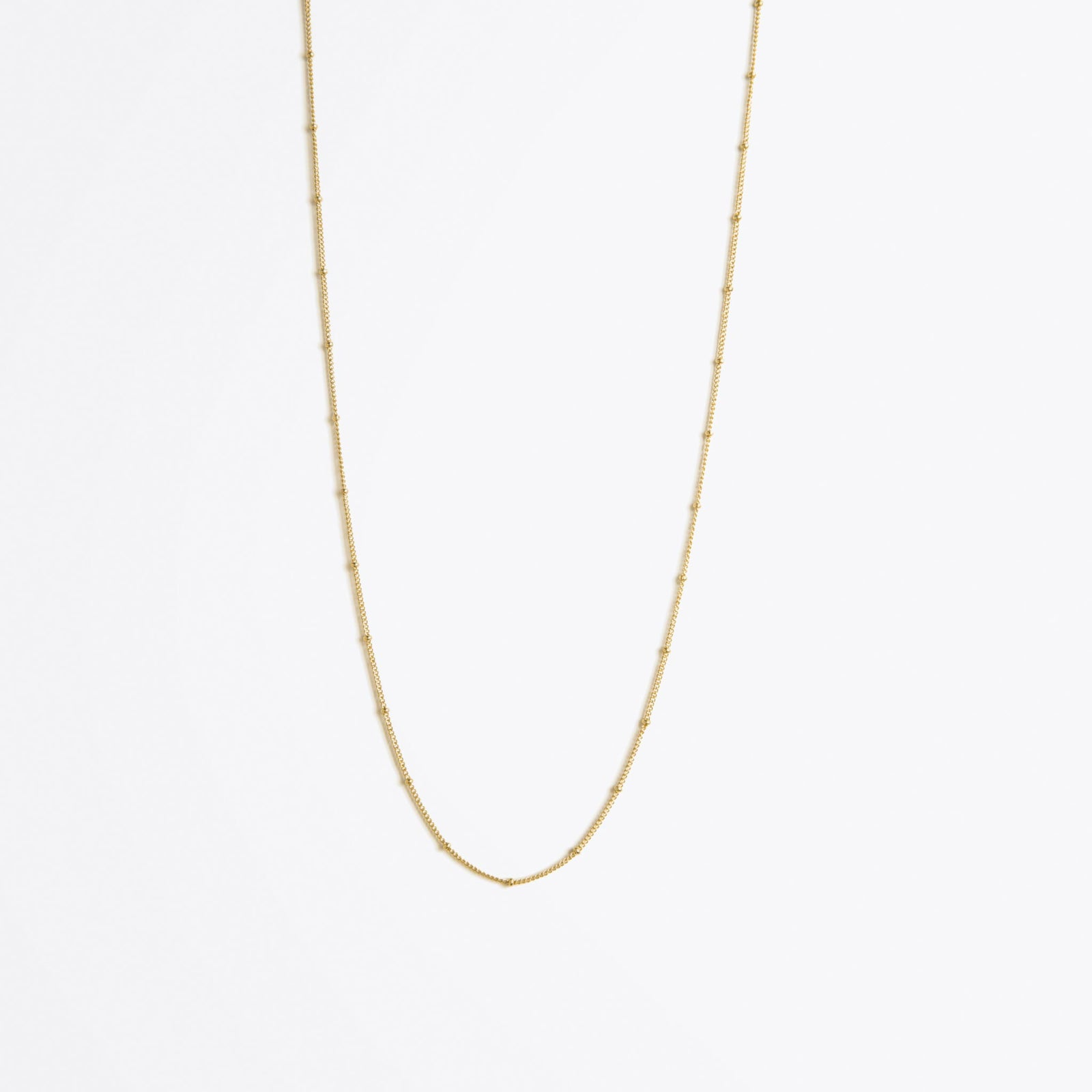 Wanderlust Life Ethically Handmade jewellery made in the UK. Minimalist gold and fine cord jewellery. satellite layering gold chain necklace, long length