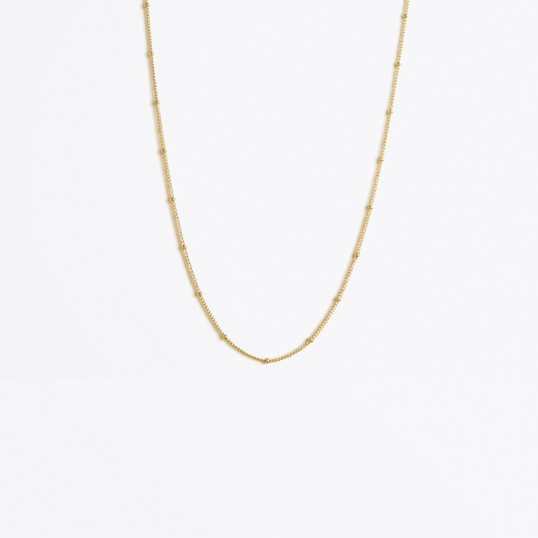 Wanderlust Life Ethically Handmade jewellery made in the UK. Minimalist gold and fine cord jewellery. satellite layering gold chain necklace, regular length