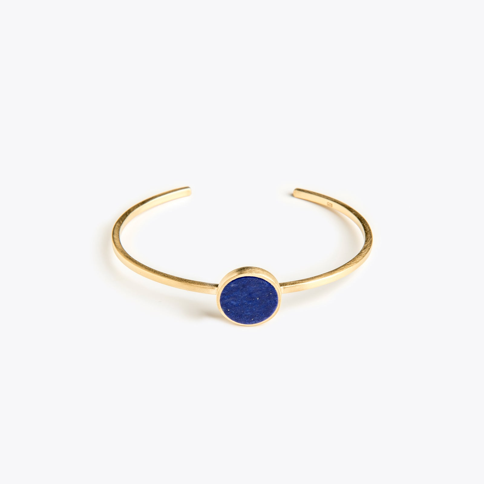 Wanderlust Life Lapis lazuli gemstone gold cuff. Designed in the UK.
