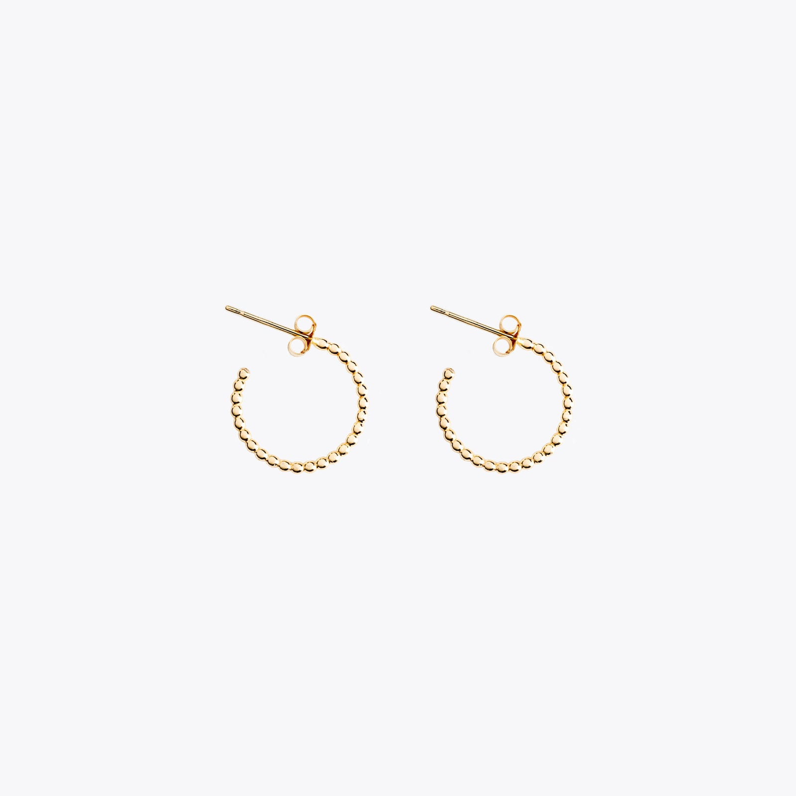 Wanderlust Life Ethically Handmade jewellery made in the UK. Minimalist gold and fine cord jewellery. solstice, petite gold hoop