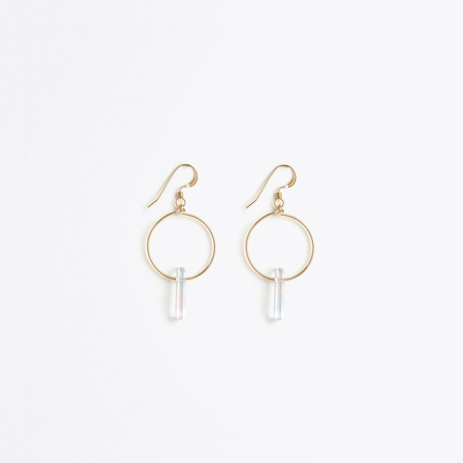 Wanderlust Life Ethically Handmade jewellery made in the UK. Minimalist gold and fine cord jewellery. talisman gold hoop earring, rainbow moonstone