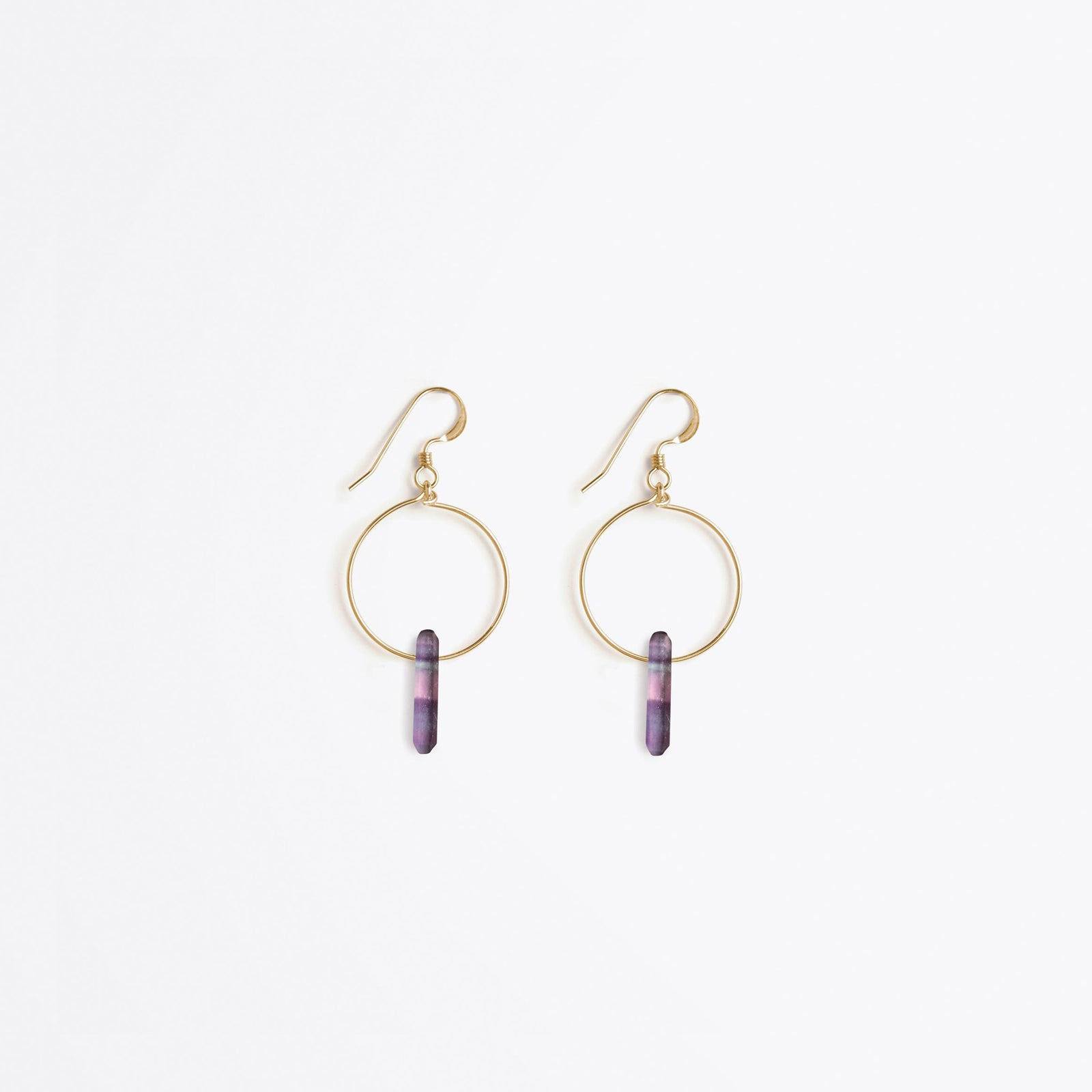 Wanderlust Life Ethically Handmade jewellery made in the UK. Minimalist gold and fine cord jewellery. talisman gold hoop earring, rainbow fluorite