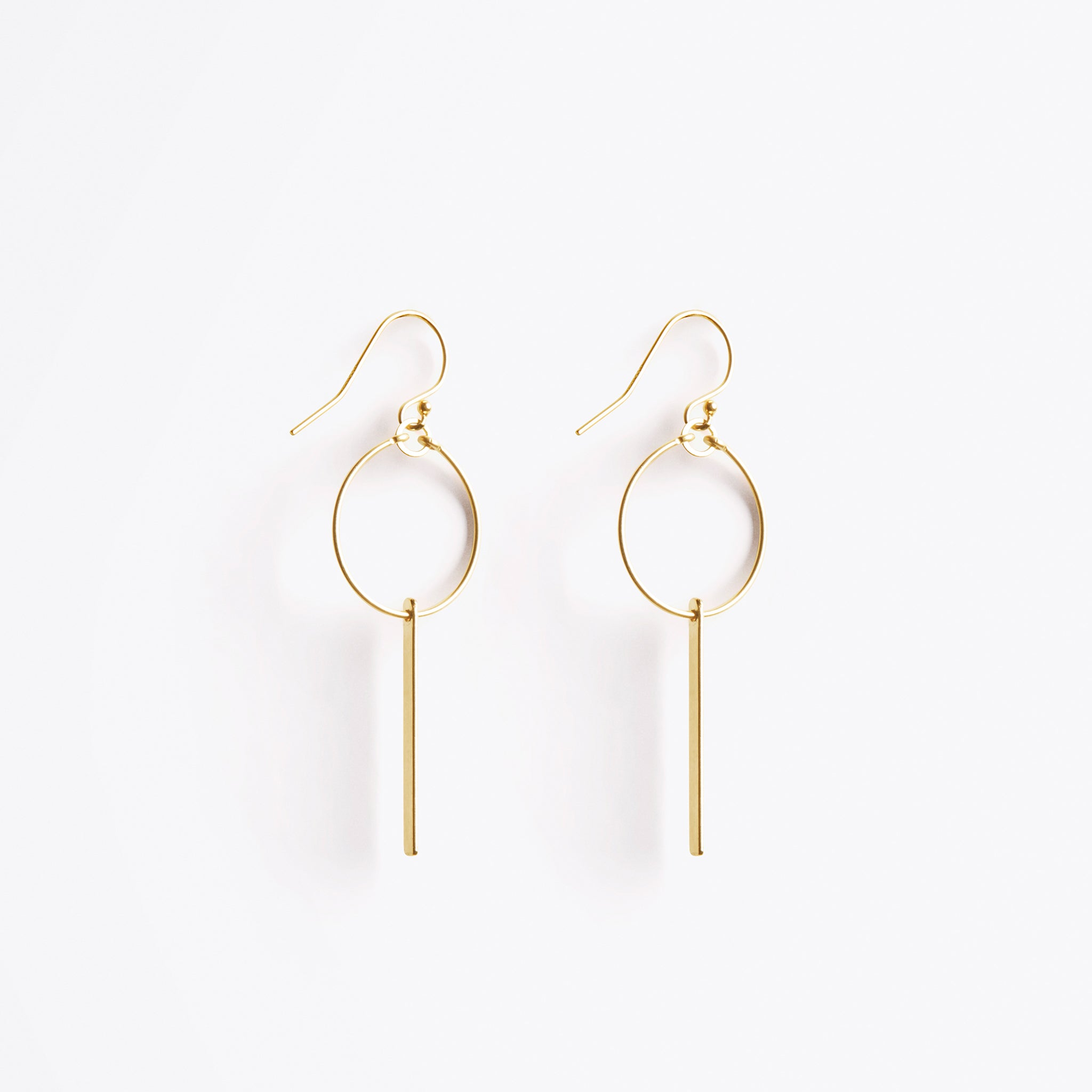 Wanderlust Life Ethically Handmade jewellery made in the UK. Minimalist gold and fine cord jewellery. aktis sculptural hoop earring