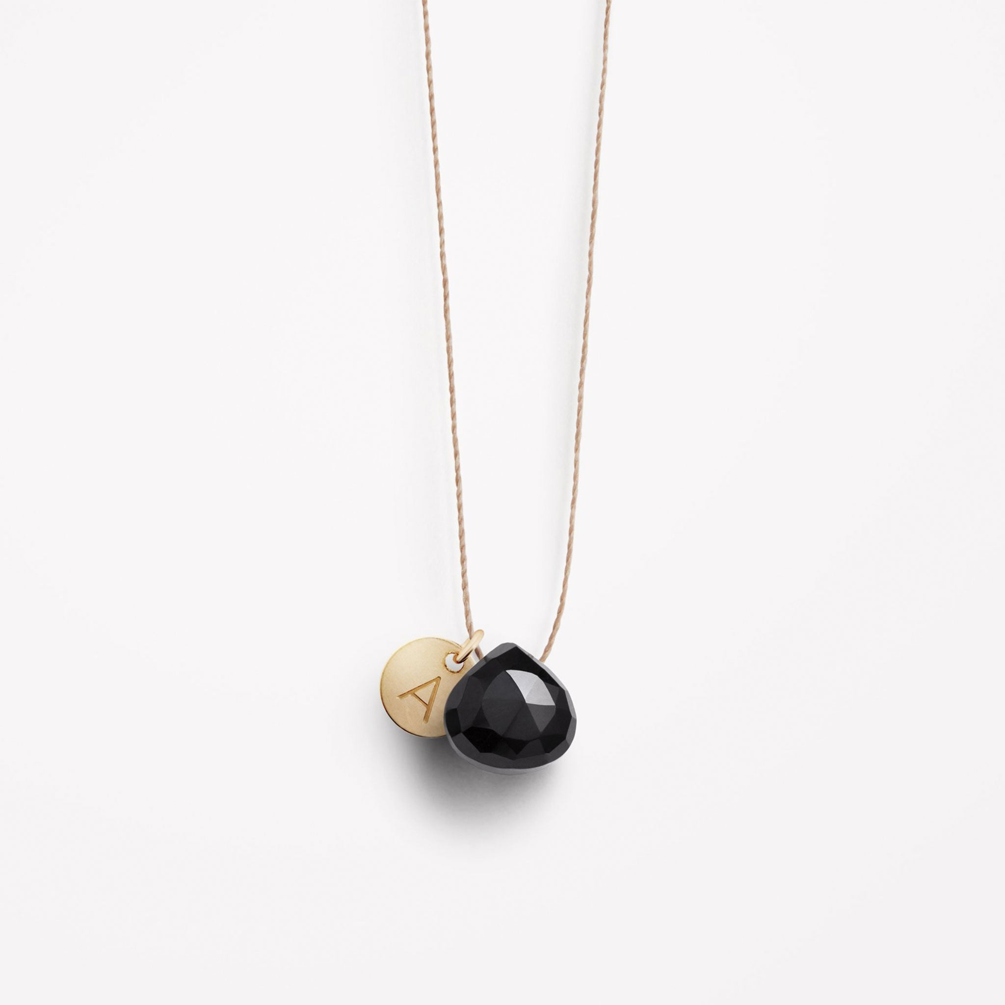 Wanderlust Life Ethically Handmade jewellery made in the UK. Minimalist gold and fine cord jewellery. Personalised Black Spinel gemstone fine cord necklace with gold personalised tag.
