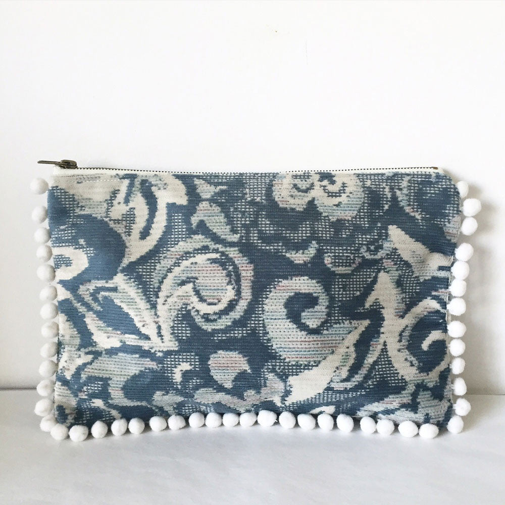 A blue blossom print clutch nene bag, made in california from vintage upholstery material