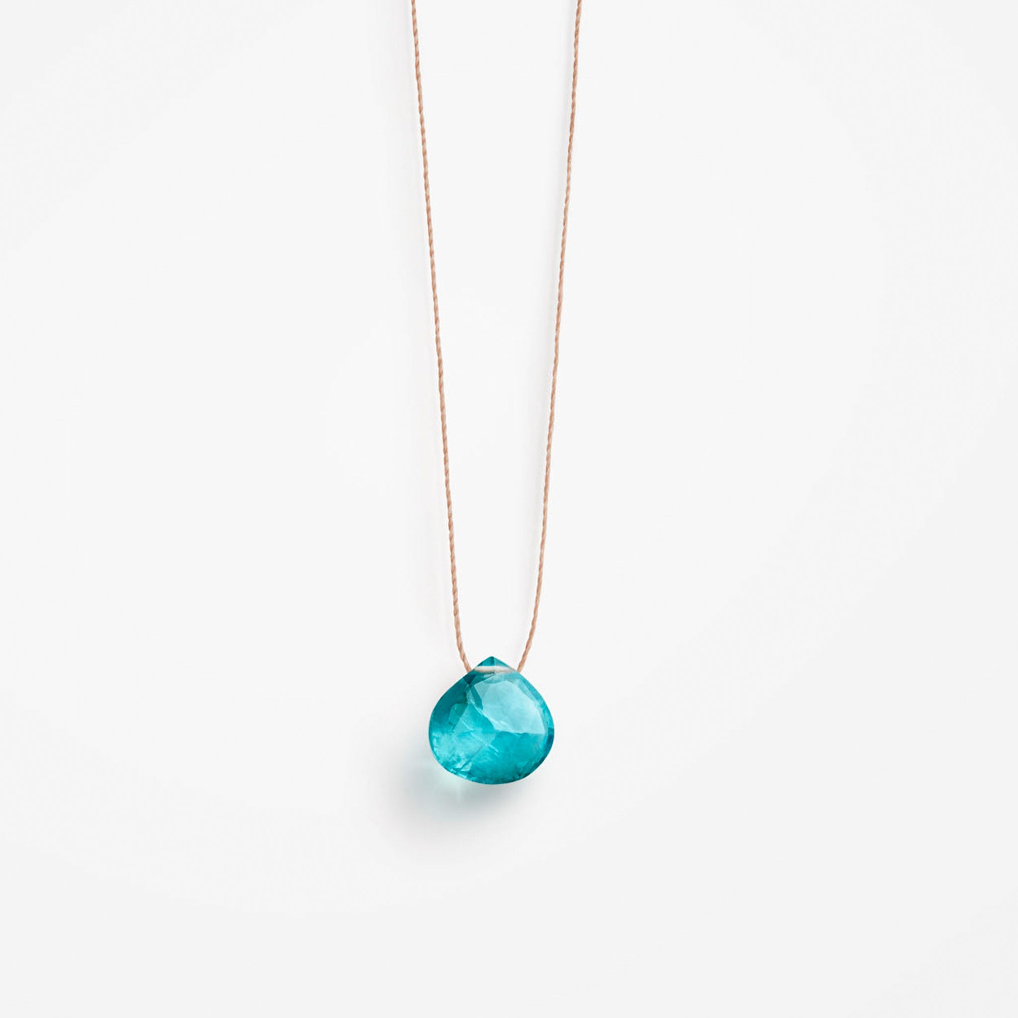 Modern & understated, a solo blue Apatite Quartz gemstone in our signature faceted shape slides on a delicate & minimalist fine cord necklace. Wanderlust Life fine cord necklaces are handmade in the UK.