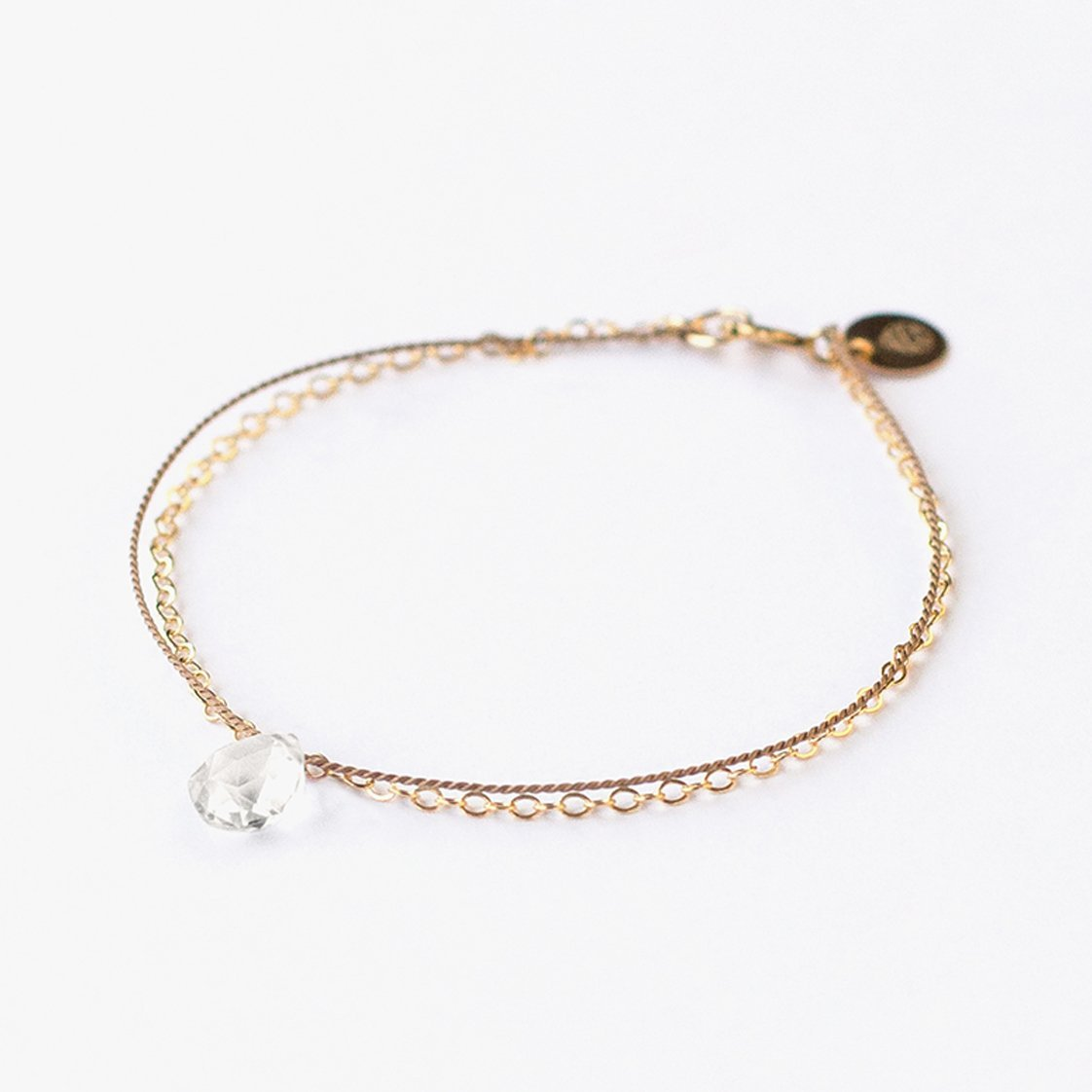 Wanderlust Life Ethically Handmade jewellery made in the UK. Minimalist gold and fine cord jewellery. april birthstone, gold & silk clear quartz bracelet