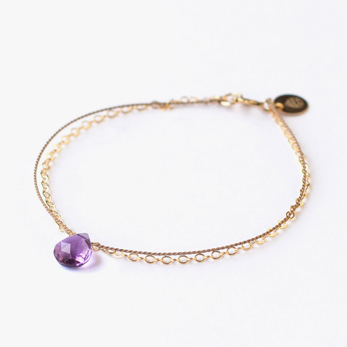 A delicate 14k gold filled Wanderlust Life chain and silk cord purple amethyst semi precious gemstone bracelet