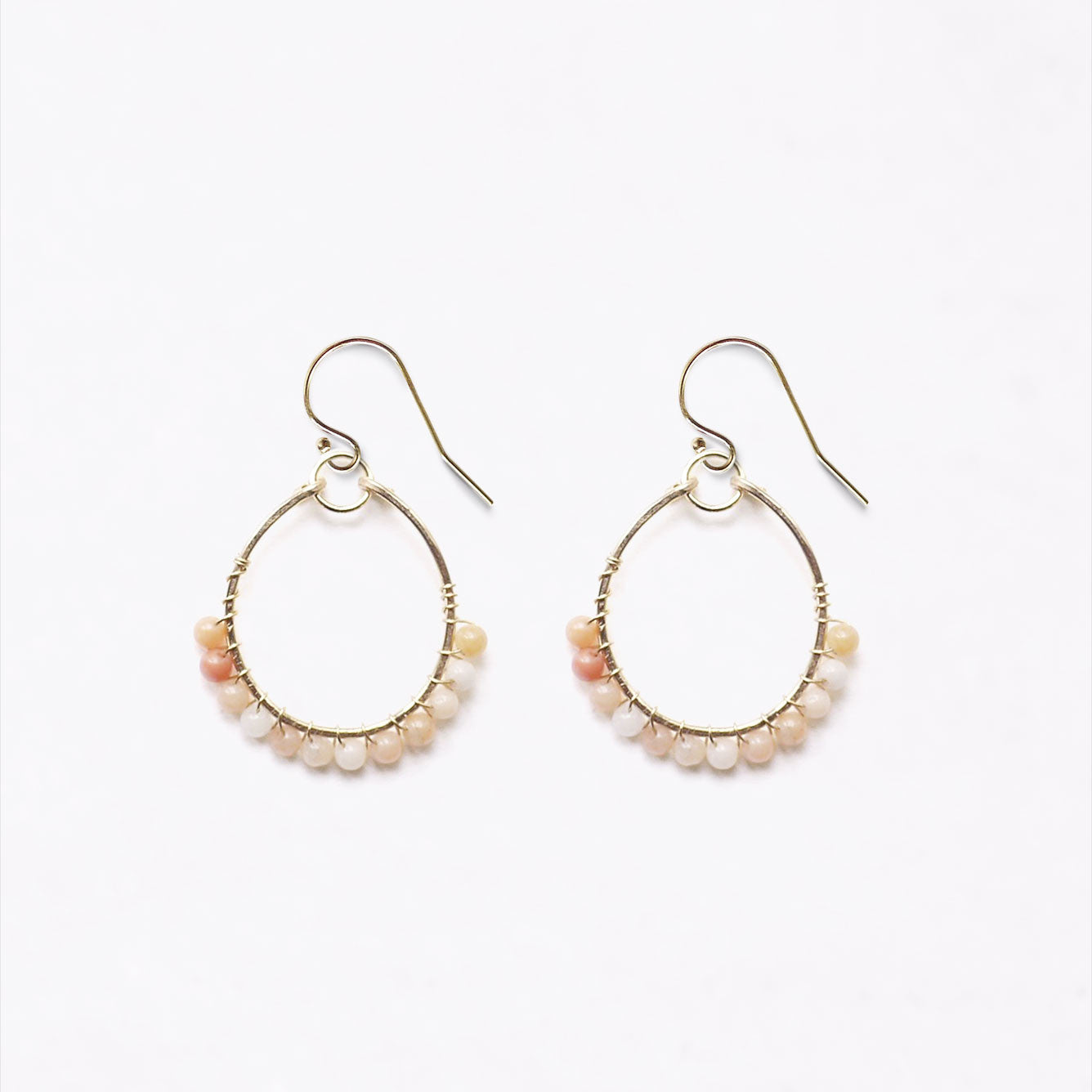 Wanderlust Life 14k gold filled hammered hoop earring with a row of delicate peach aventurine beads