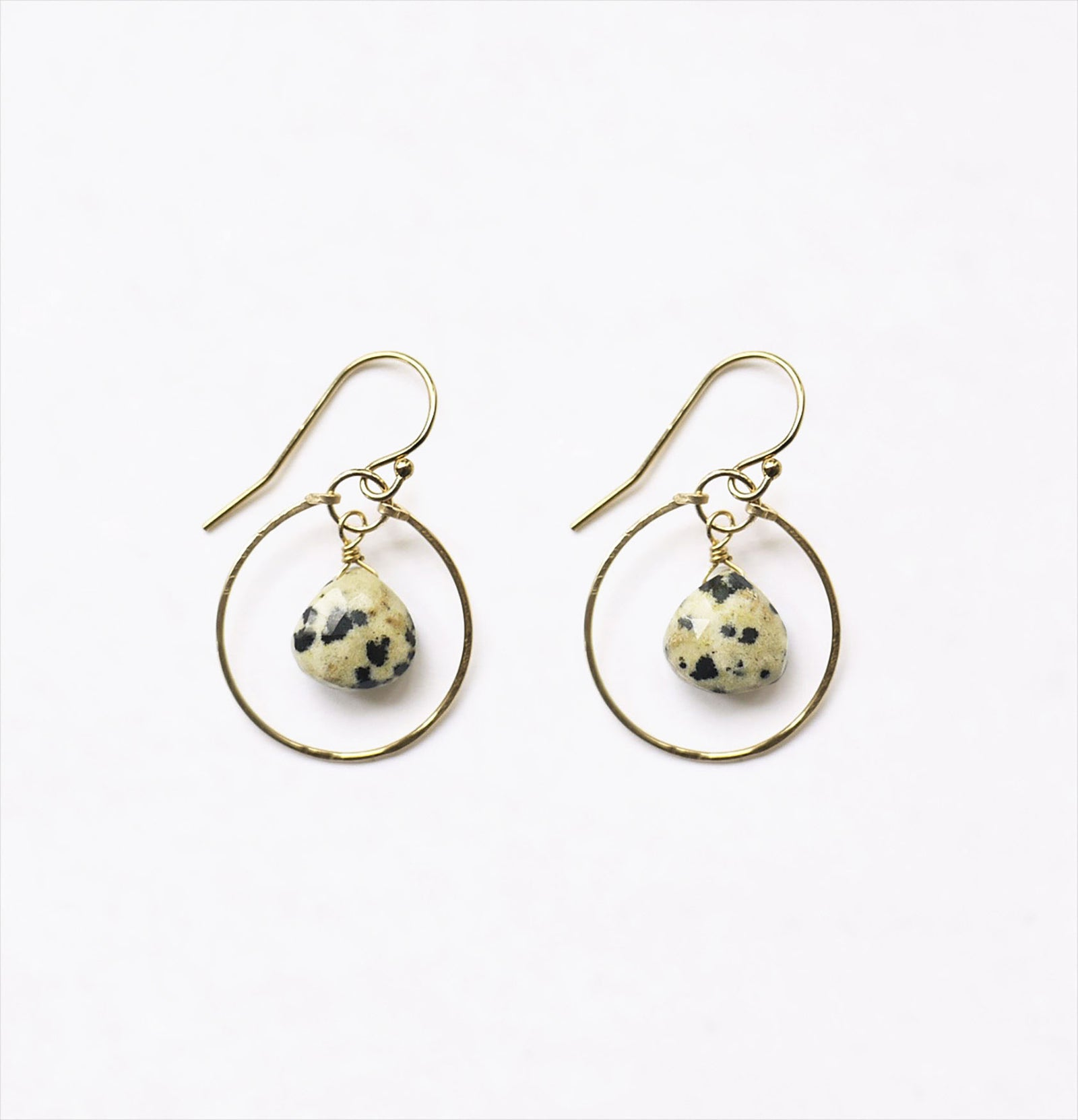 Wanderlust Life 14k gold filled hammered hoop earring with a suspended dalmatian jasper faceted semi precious gemstone