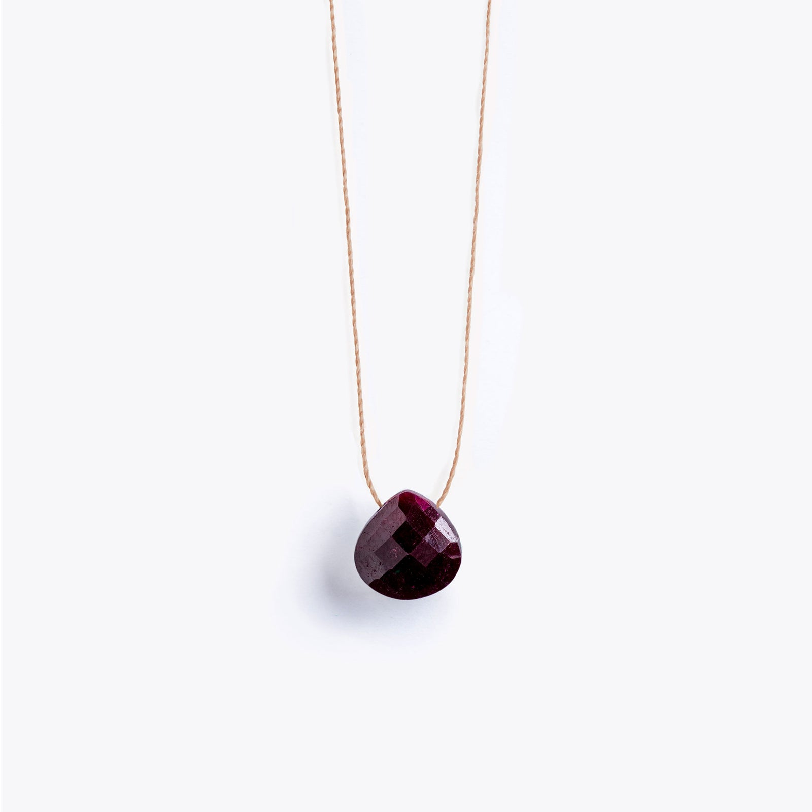 Wanderlust Life Ethically Handmade jewellery made in the UK. Minimalist gold and fine cord jewellery. ruby fine cord necklace