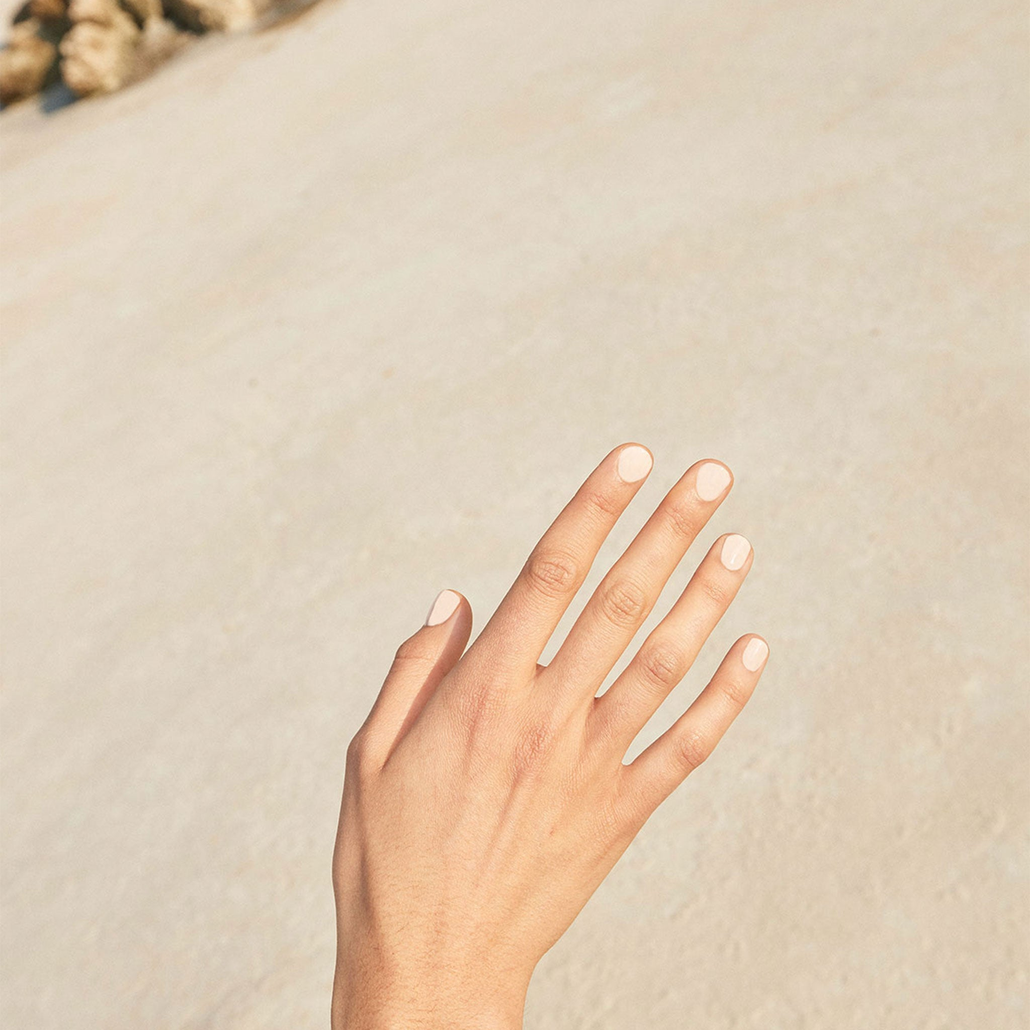 Pair your favourite Wanderlust Life jewellery with a clean, simple manicure created with sustainable, non toxic ingredients. Shop the Licia Florio 'Anacardo' nude nail polish shade at Wanderlust Life jewellery, UK stockist of Licia Florio vegan nail polishes.