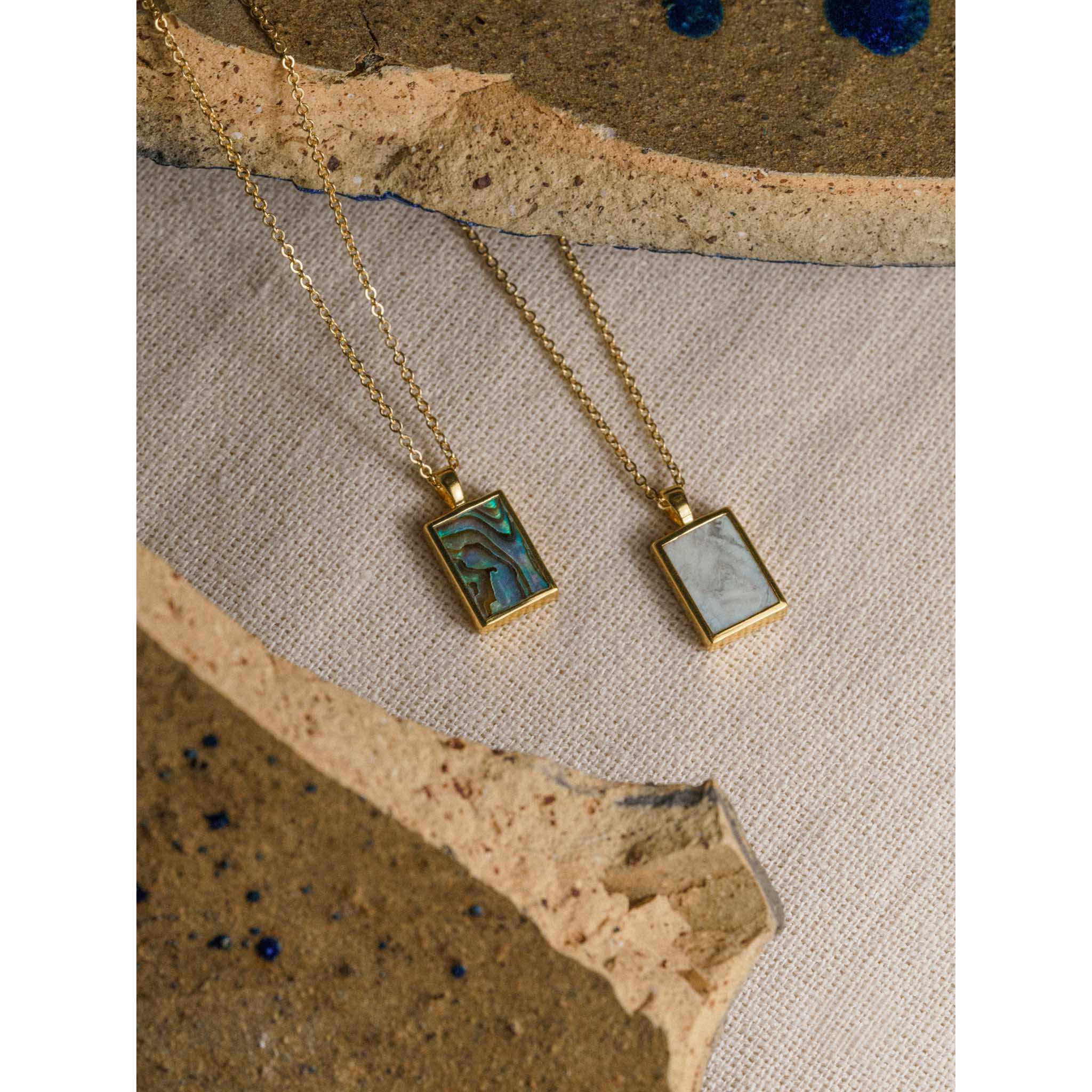 Handmade gold necklace with howlite gemstone pendant. Gemstone necklace ideal for layering with other gold jewellery. Unique jewellery from Wanderlust Life. Minimalist jewellery made in Devon in the UK.
