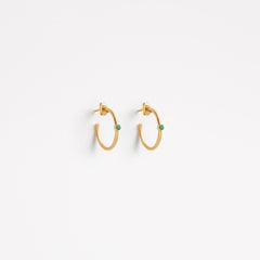 Wanderlust Life large gold hoop with semi precious emerald gemstone also available in small gold hoop. Perfect hoop earrings for layering.