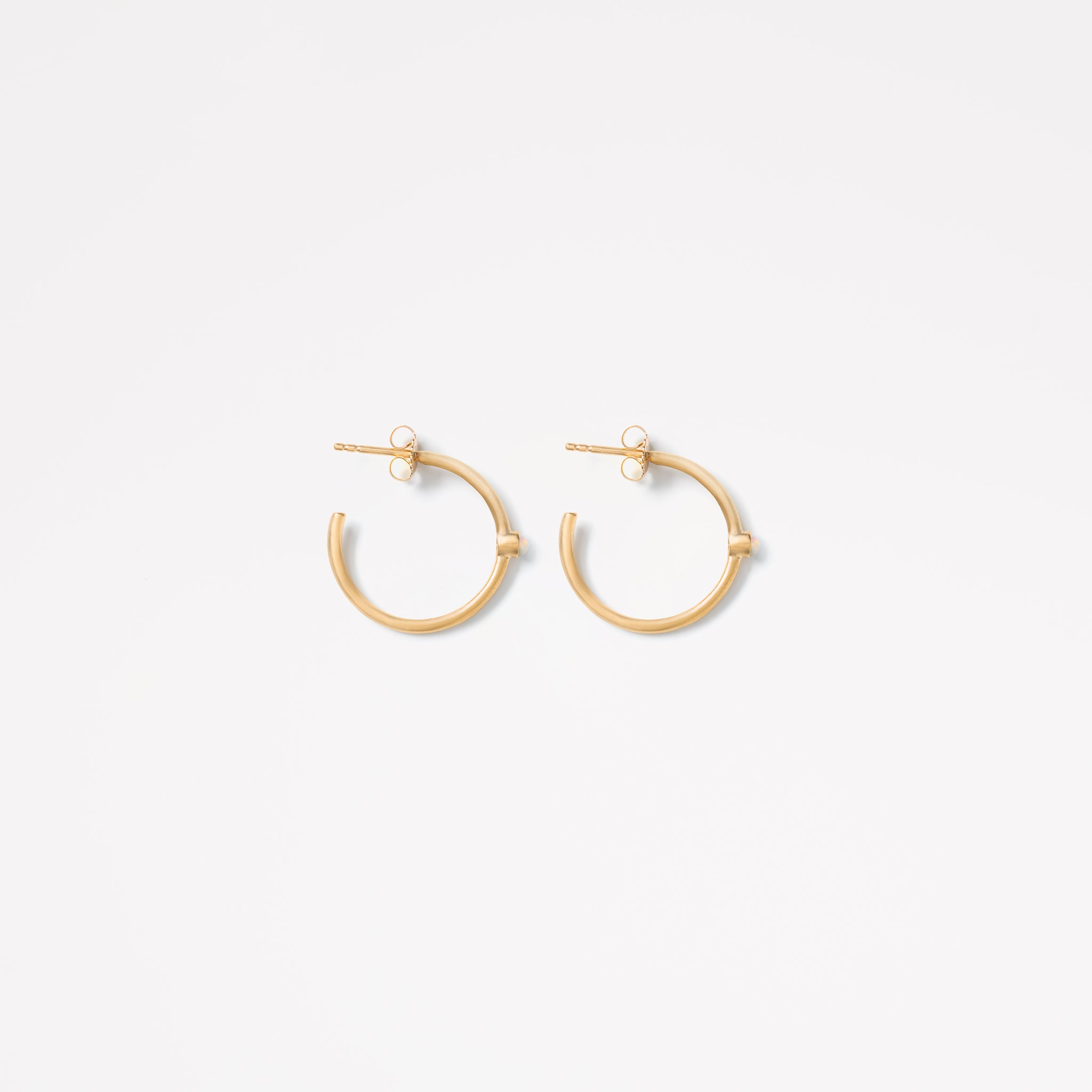 Wanderlust Life large gold hoop Astrea earrings with semi precious opal gemstones. Stack your hoops with the Astrea petite gold hoop opal earrings. Wanderlust Life jewellery designed in the UK.