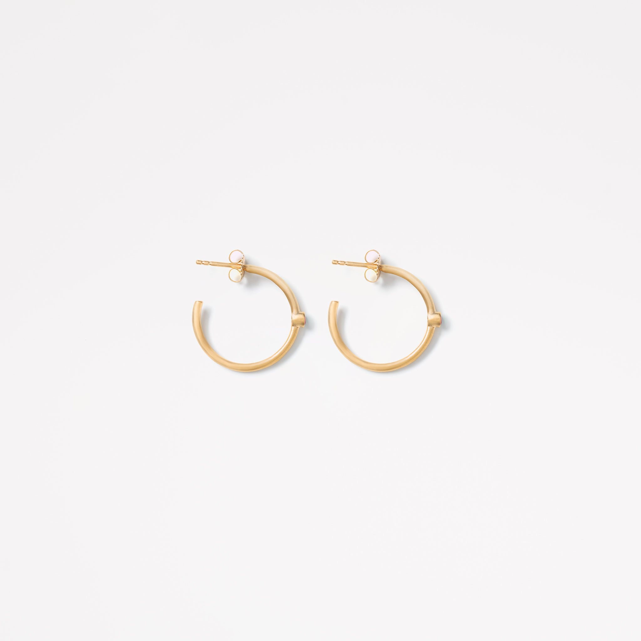 Wanderlust Life large gold hoop Astrea earrings with semi precious ruby gemstones. Stack your hoops with the Astrea petite gold hoop ruby earrings. Wanderlust Life jewellery designed in the UK.