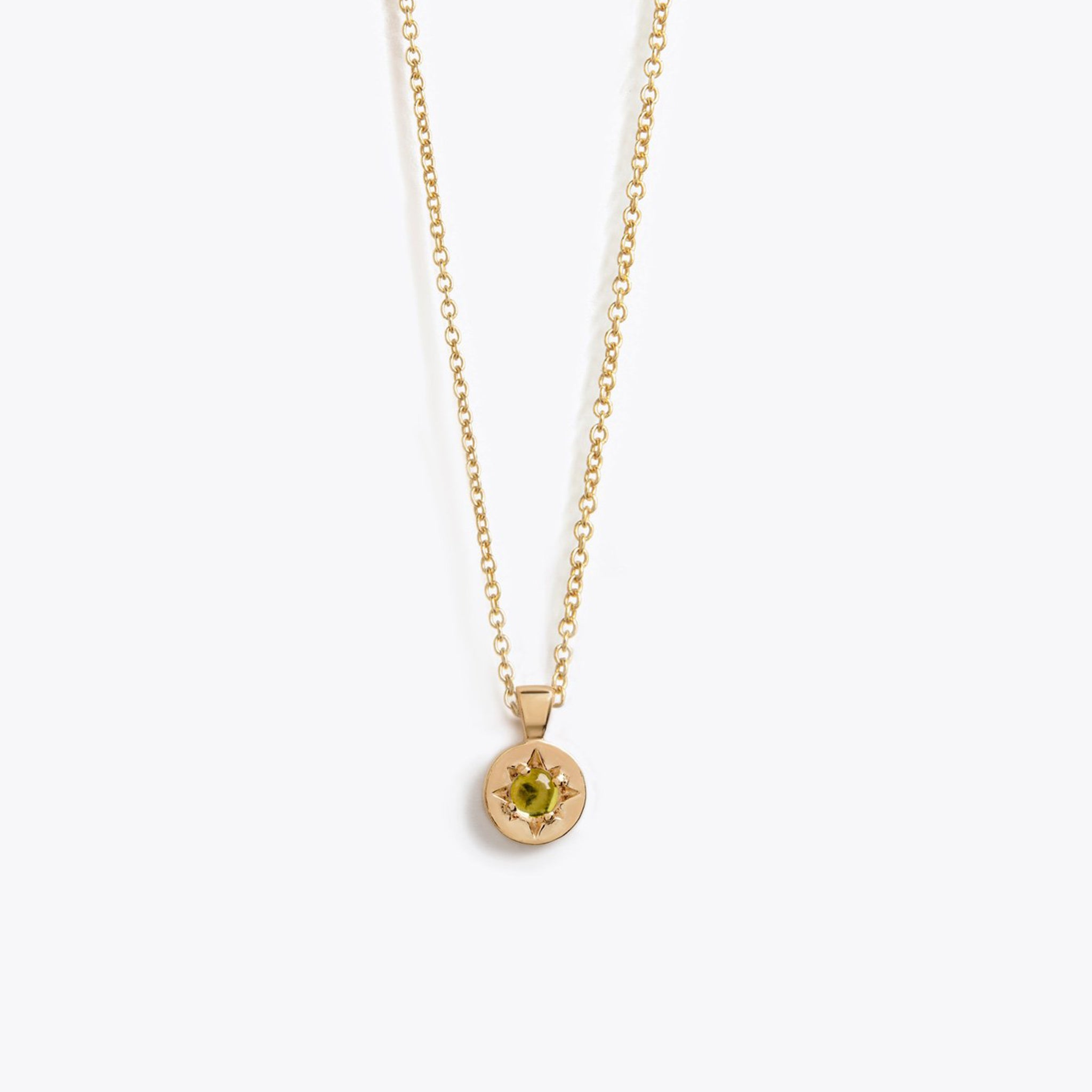 Wanderlust Life August birthstone 14k gold fill charm necklace featuring semi precious green peridot gemstone symbolising the month of August. August birthstone gold necklace available in 17