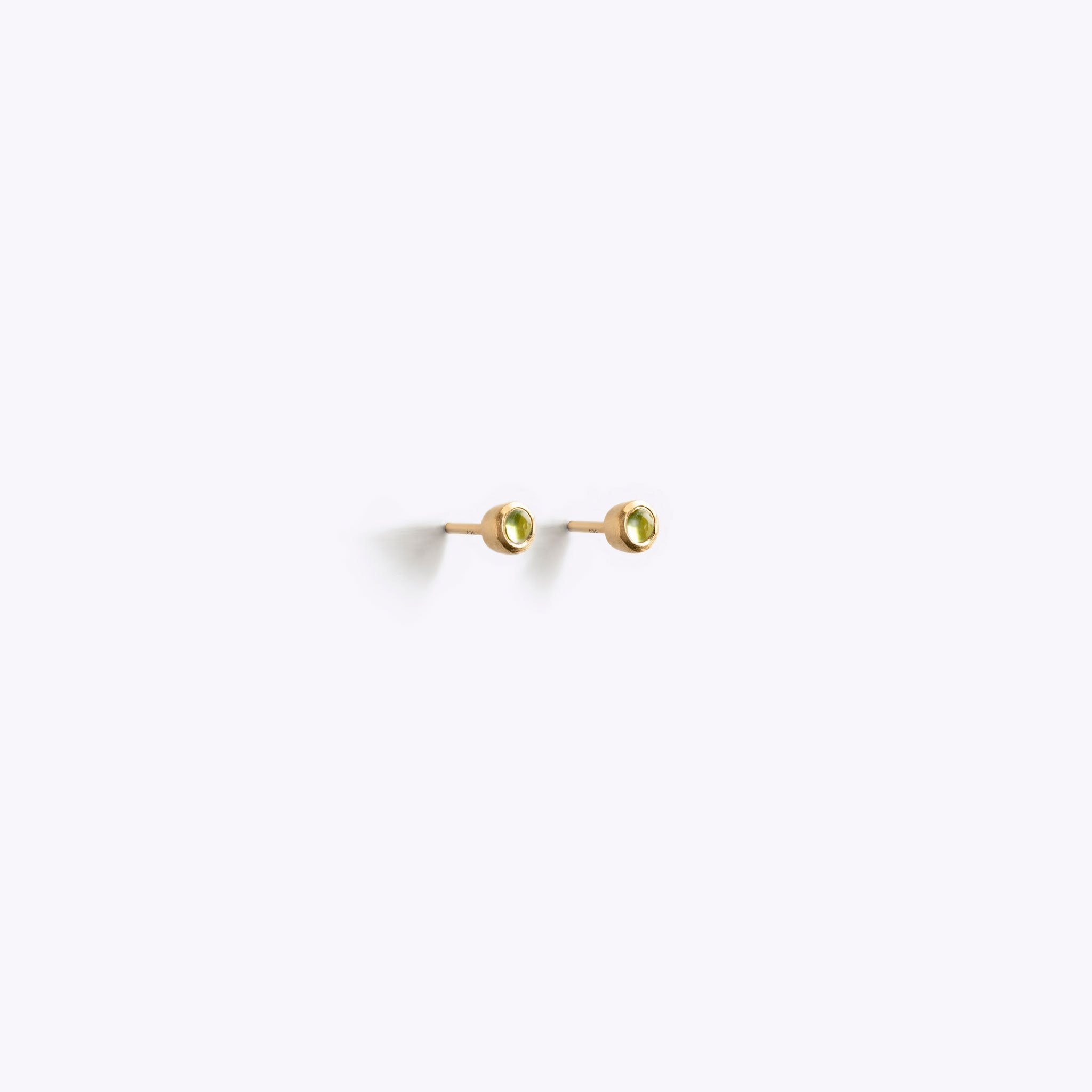 Wanderlust Life Ethically Handmade jewellery made in the UK. Minimalist gold and fine cord jewellery. August birthstone gold stud earrings. Peridot gemstone earrings.