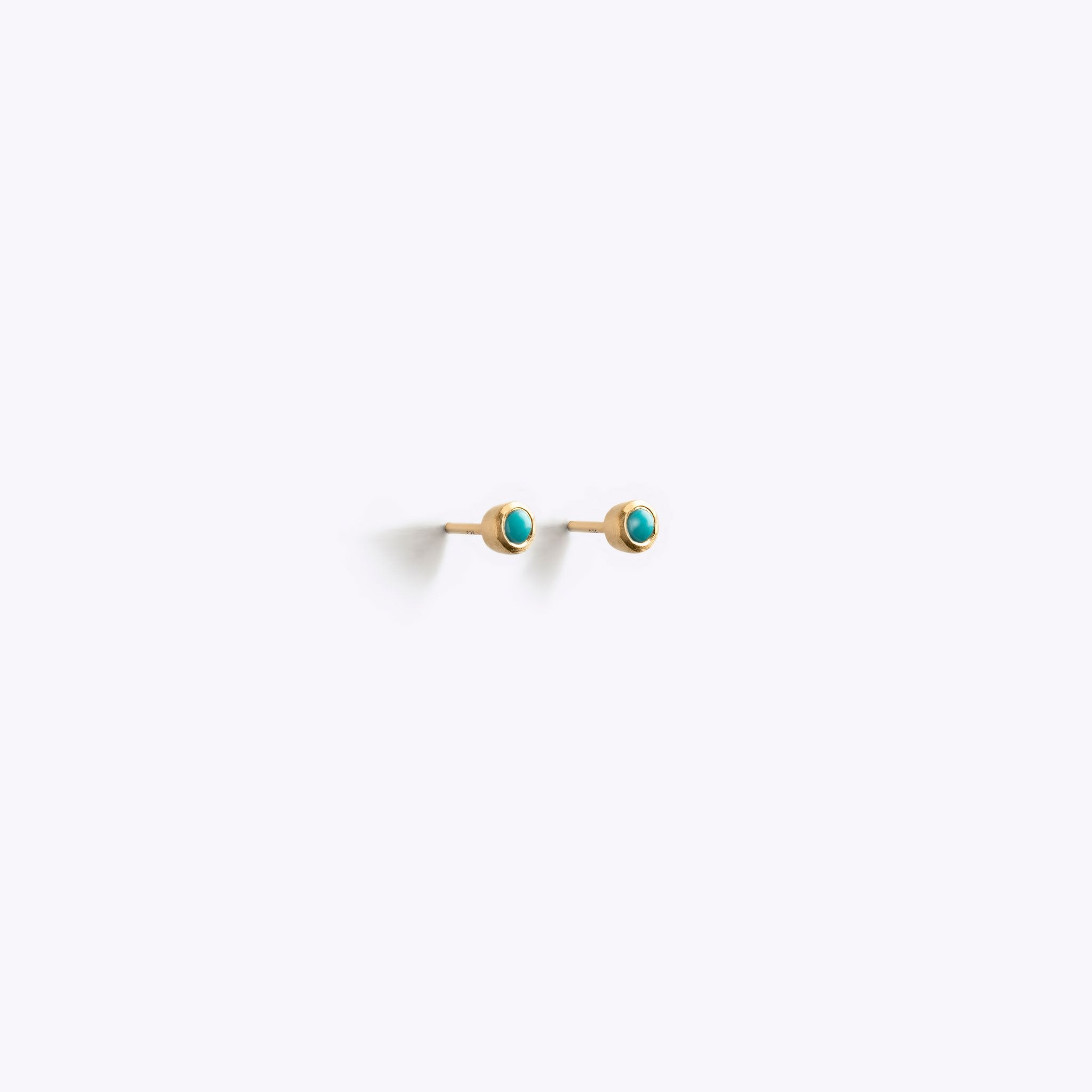 Wanderlust Life Ethically Handmade jewellery made in the UK. Minimalist gold and fine cord jewellery. December birthstone earrings. Arizona Turquoise gold stud gemstone earrings.