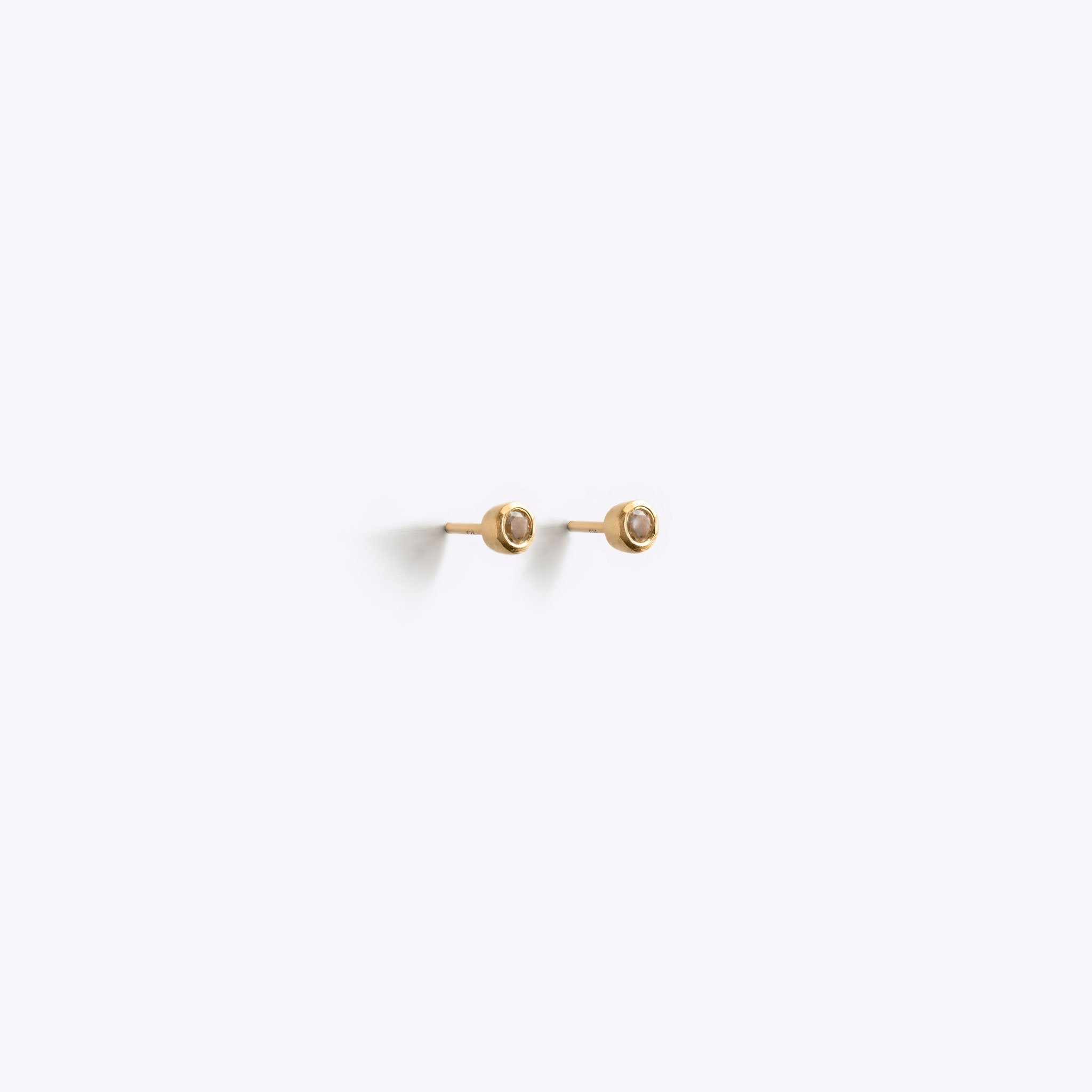 Wanderlust Life Ethically Handmade jewellery made in the UK. Minimalist gold and fine cord jewellery. February birthstone gold stud earrings. Mint amethyst gemstone earrings.