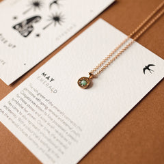Wanderlust Life May birthstone 14k gold fill charm necklace featuring semi precious emerald gemstone symbolising the month of May. May birthstone gold necklace available in 17