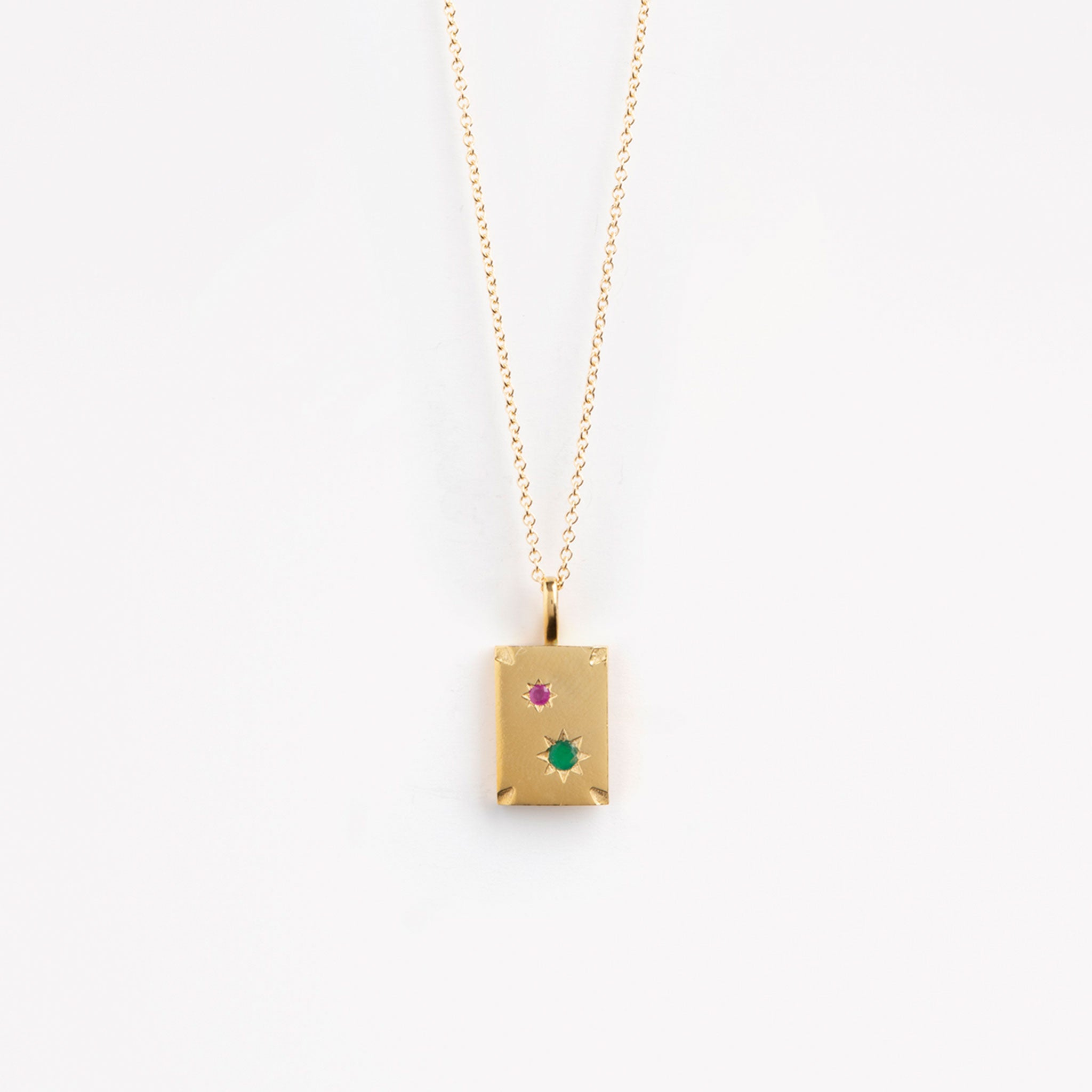 Wanderlust Life gold chain necklace with star-set ruby & emerald gold rectangular tab. Available in a 14k gold fill rope chain necklace and 14k gold fill fine gold chain necklace. The perfect gold chain gemstone necklace for gifting.