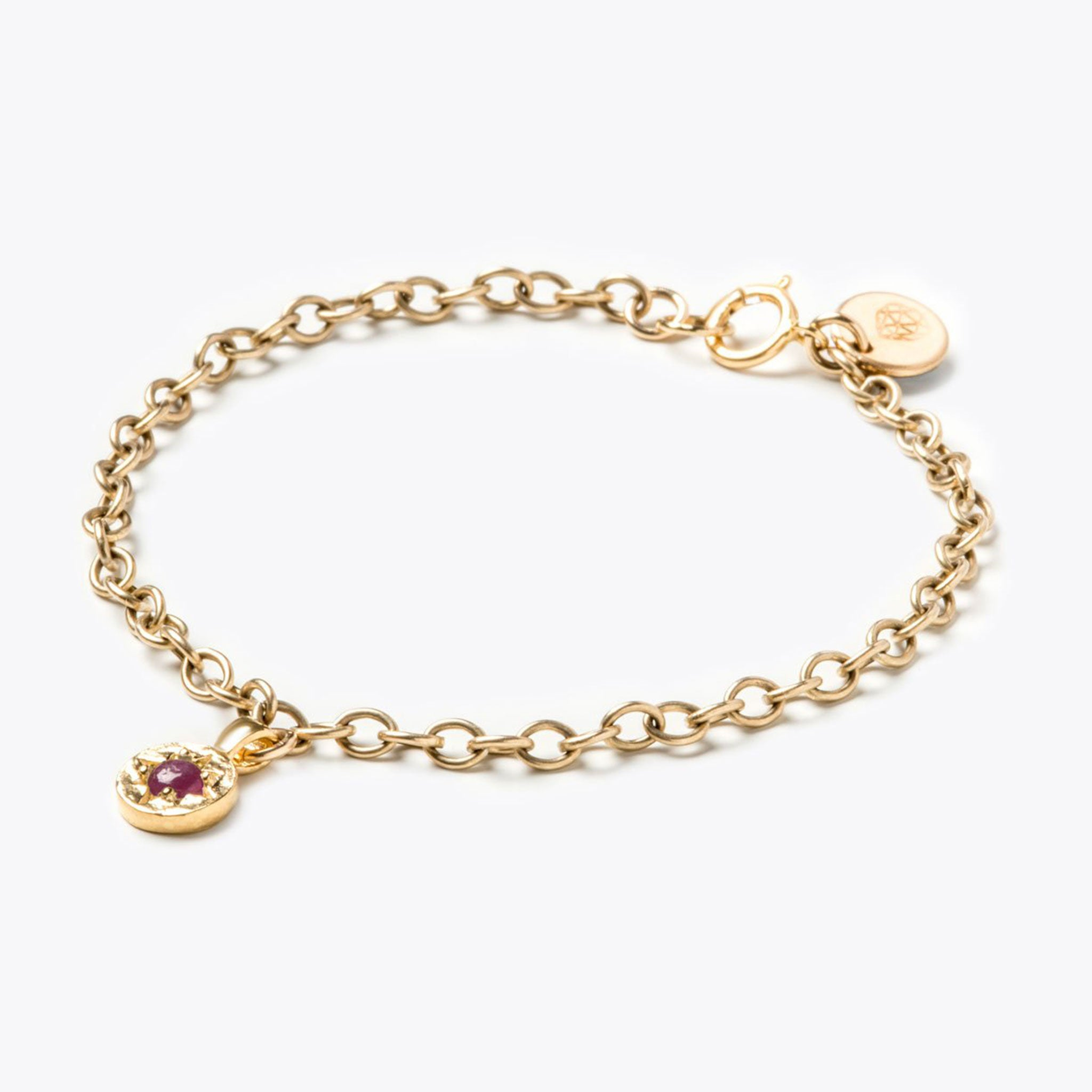 Wanderlust Life July birthstone 14k gold fill charm bracelet featuring semi precious ruby gemstone symbolising the month of July. July birthstone gold bracelet available in small 6.5